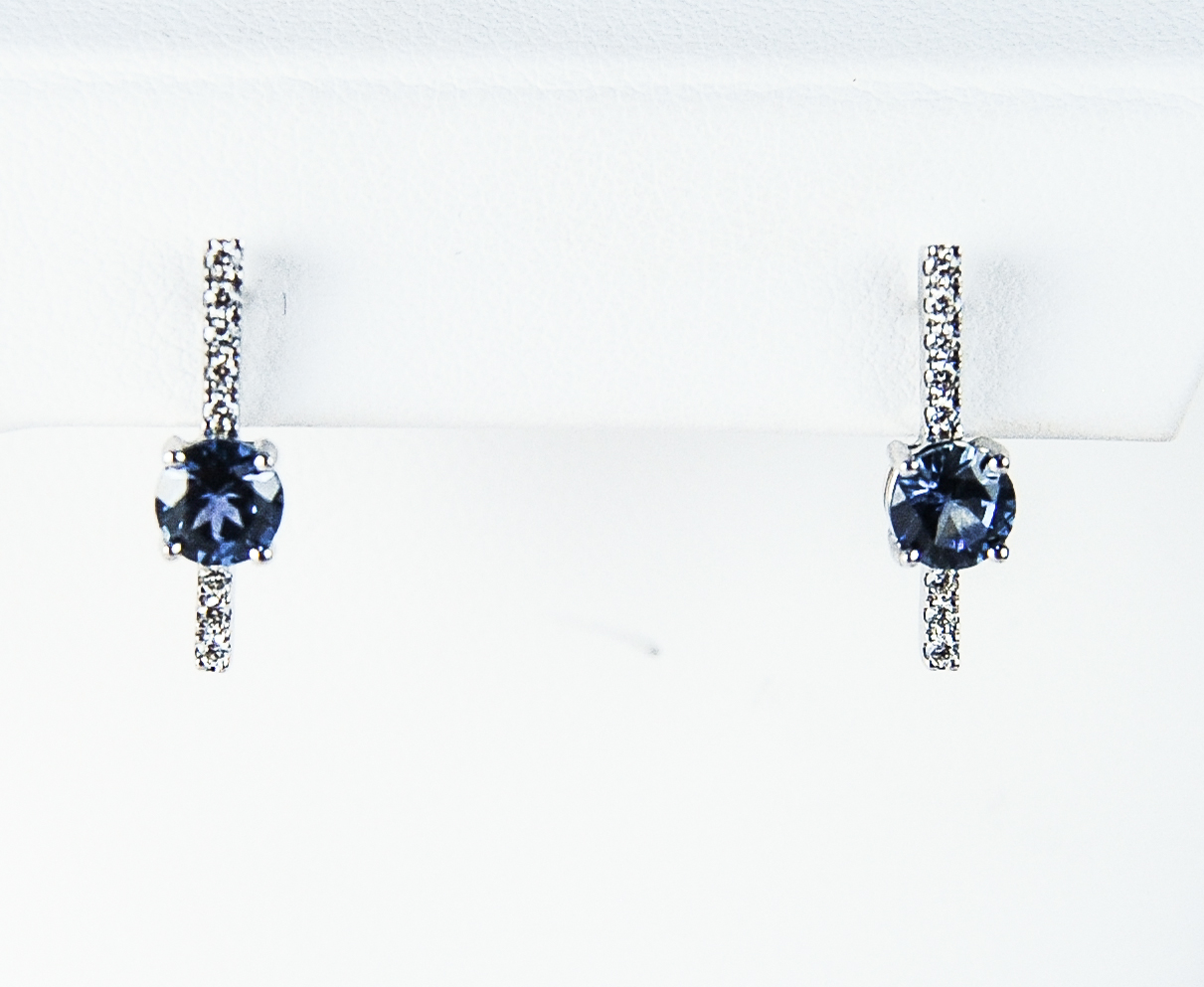 210-2217    14 Karat White Gold Drop Earrings With 2=1.18Tw Round MT Sapphires And 0.15Tw Round Diamonds $1,627.00