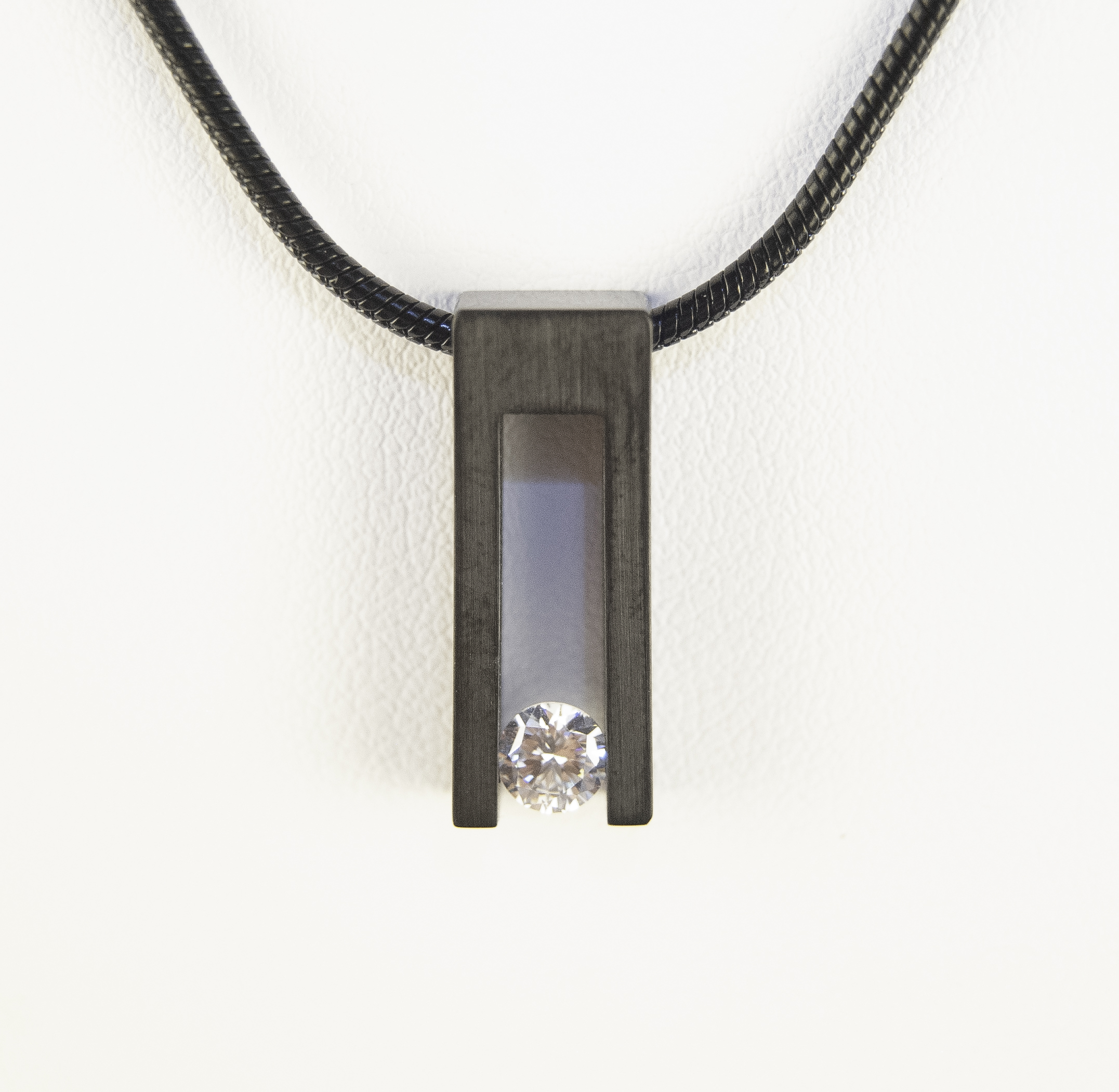 765-12   Black Stainless Steel Bar Pendant With One Round Cubic Zirconium, 20' Black Snake Chain $105.00