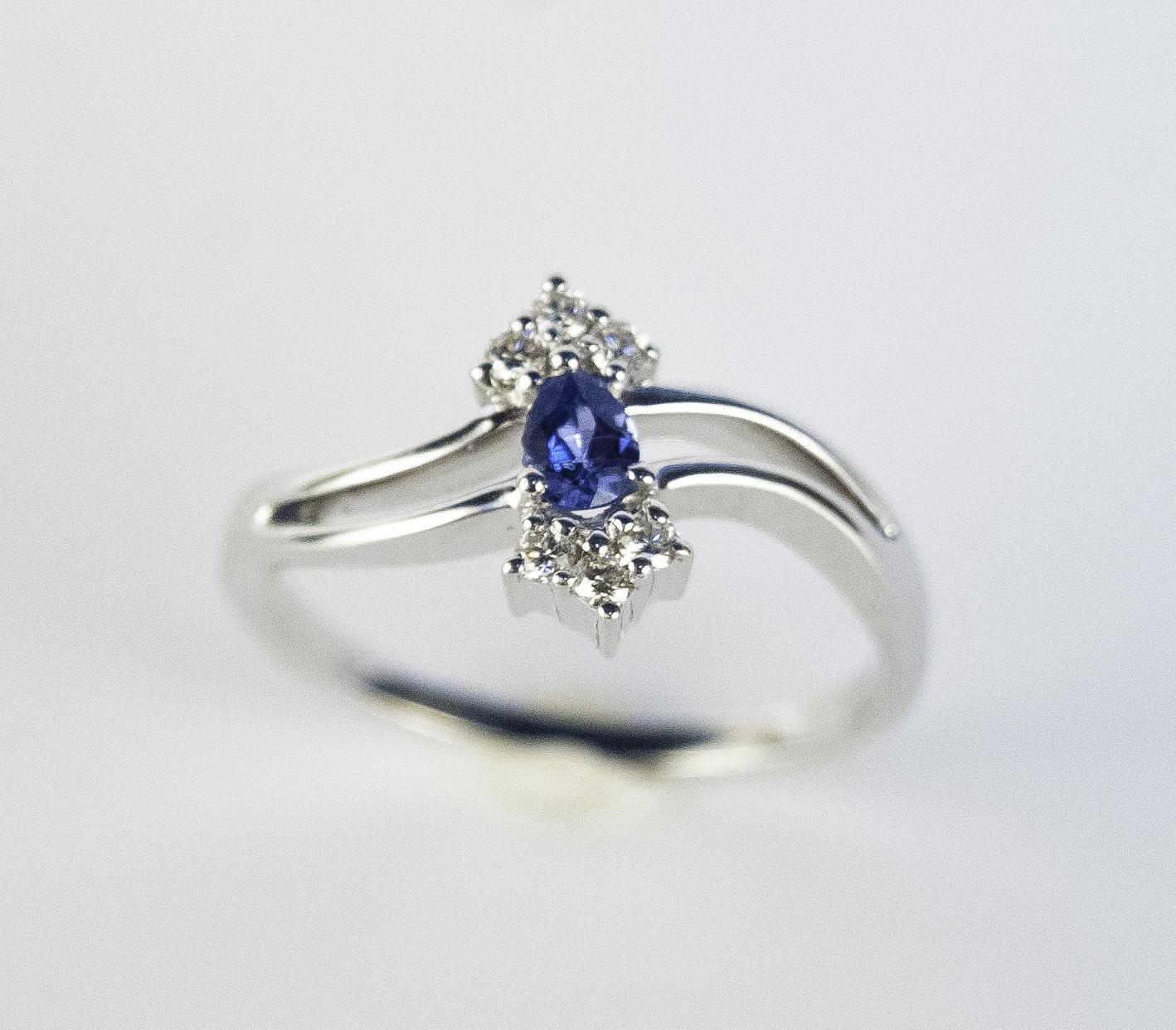 200-899   14 Karat White Gold Fashion Ring Size 7 With One 0.23Ct Marquise Yogo And 6=0.14Tw Round Diamonds $1,167.00