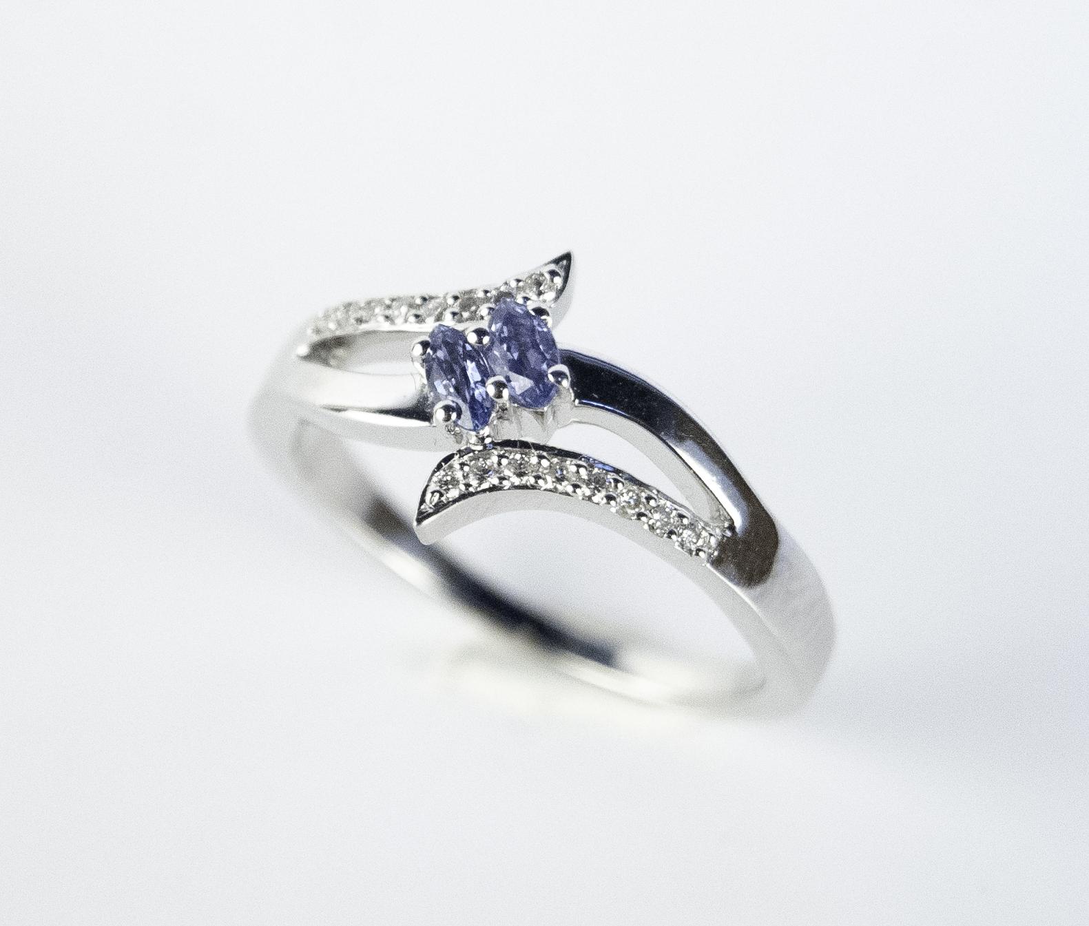 200-900   14 Karat White Gold Fashion Ring Size 7 With 2=0.30Tw Marquise Yogos And 0.20Tw Round Diamonds $1,135.00