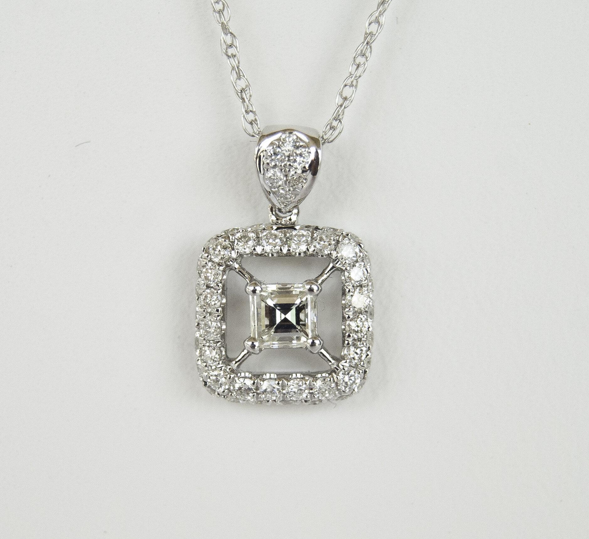 160-397   14 Karat White gold Halo Pendant With One 0.25Ct Emerald Cut Diamond And 0.40Tw Round Diamonds  14K WG Rope Chain  $1,680.00