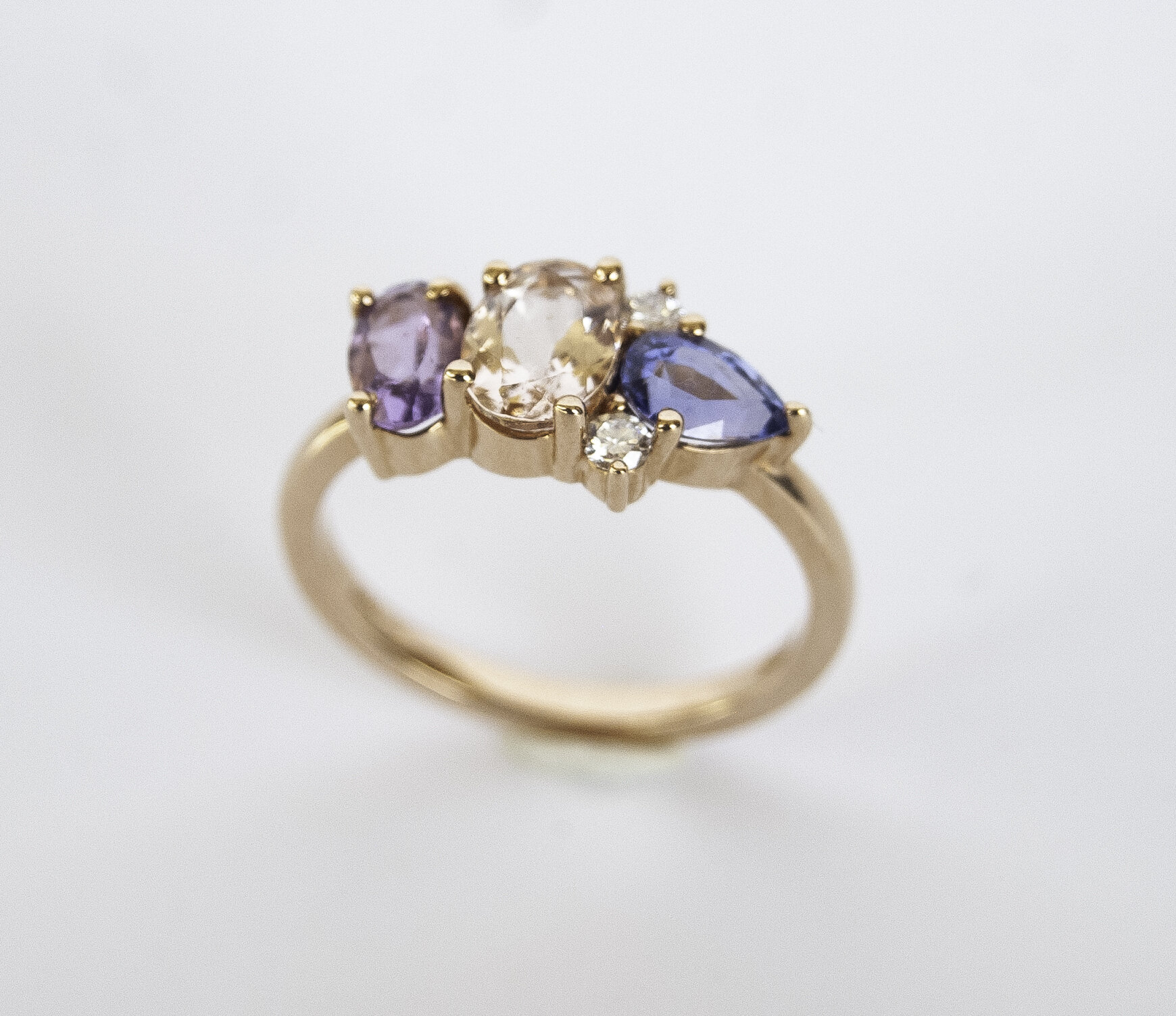 200-913   14 Karat Rose Gold 3 Stone Fashion Ring Size 6.25  one 0.70ct Oval Morganite, one 0.40ct Oval Amethys, one 0.58ct Pear Sapphire  2=0.08tw Round Diamonds $1,863.00