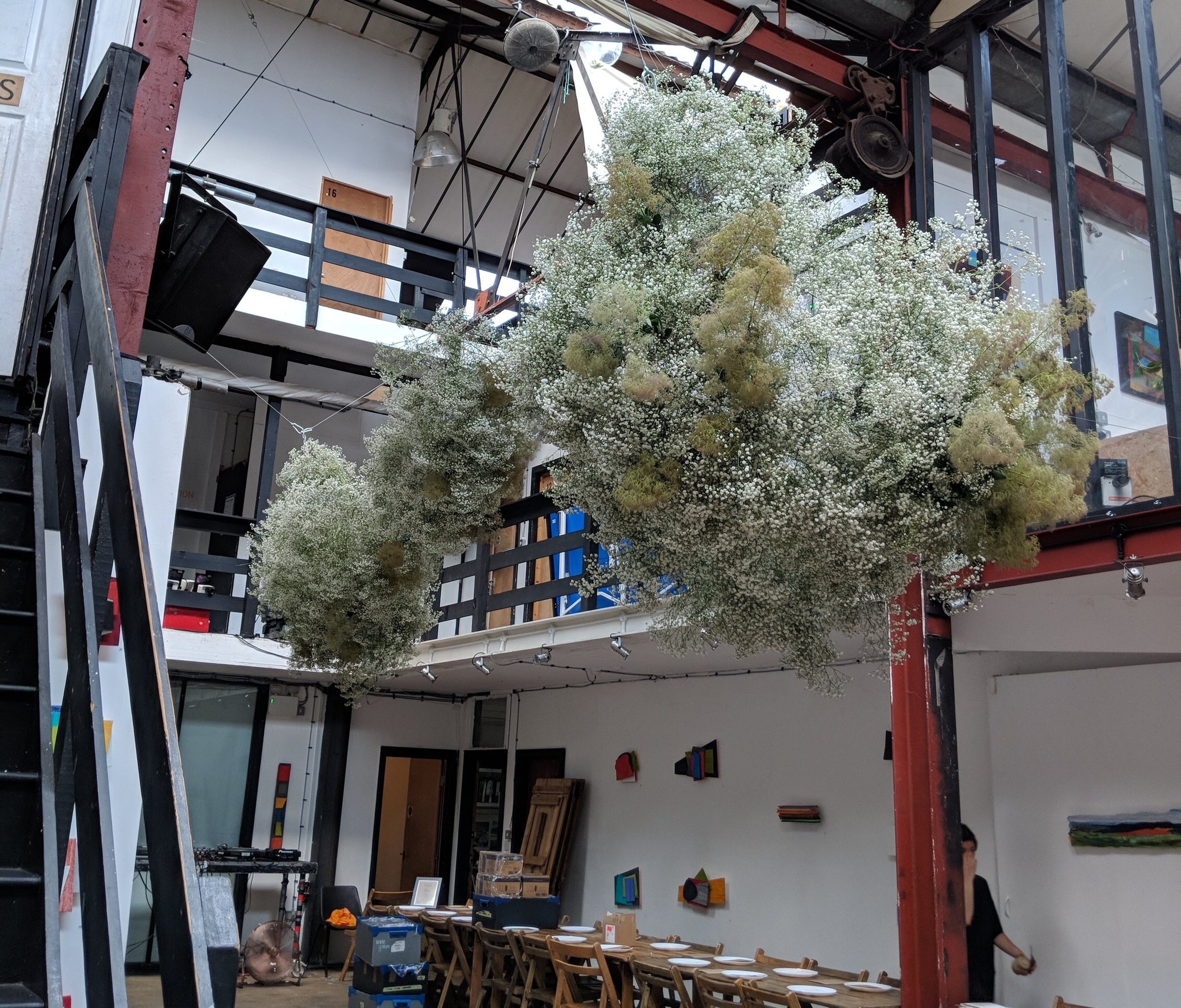 Charlie & Nick's flower cloud at Stour Space. Gypsophela and Smoke Bush both made a lighter, airier shape possible.