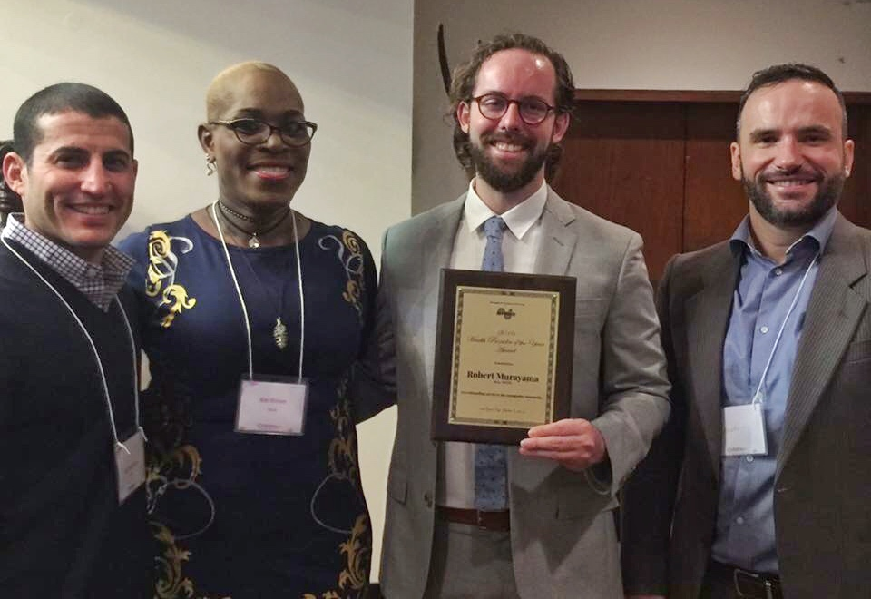 Ms. Kim Watson, Board Member of Project AFFIRM, presents the 2016 Health Provider of the Year Award to Dr. Murayama.Phil Miner, Director of Grants and Communications at APICHA, accepted the award.