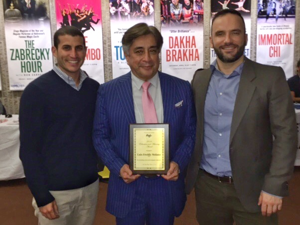 Will Mellman, Coordinator of Project AFFIRM, and Renato Barucco, Coordinator of The Program for the Study of LGBT Health, present the 2016 Education and Advocacy Award to Dr. Luis Freddy Molano.