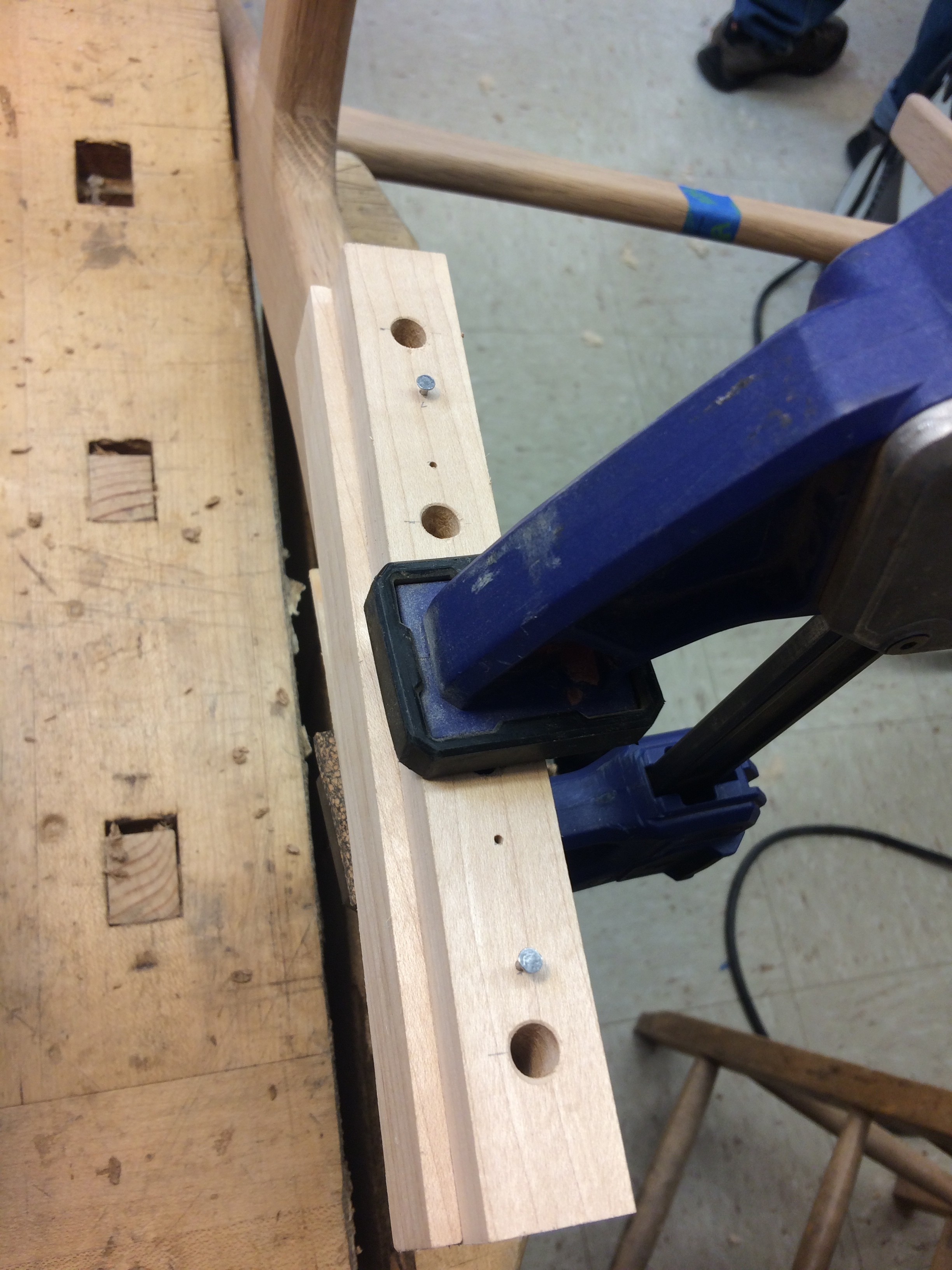 A custom jig ensures the holes are drilled in the correct orientation relative to the joint.