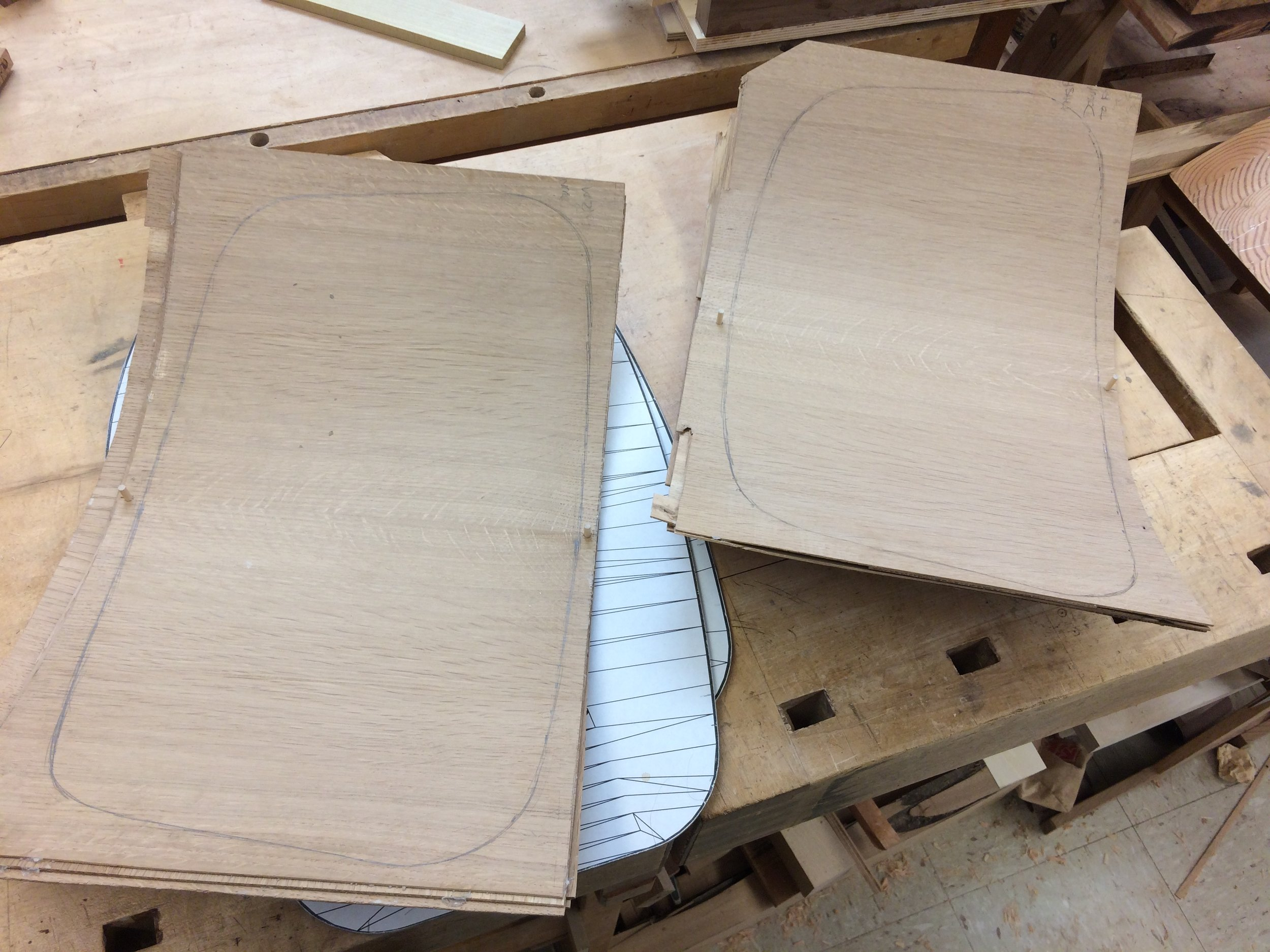 After a few hours in the press, the plywood shells are marked for bandsawing to the final contour.