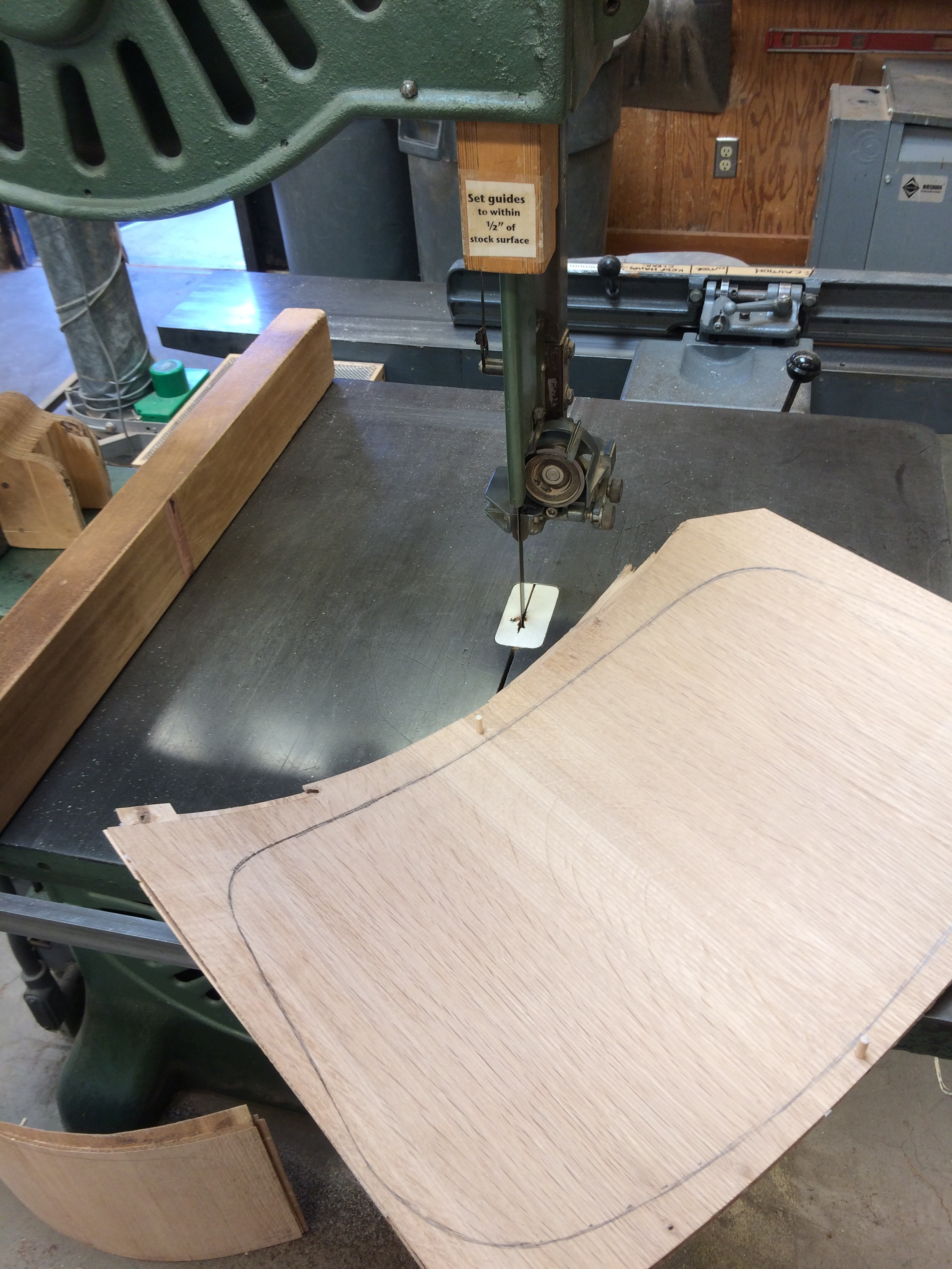 The bandsaw makes quick work of the waste. A compass planes, block plane, and spokeshaves will remove the tool marks and fair the curves.