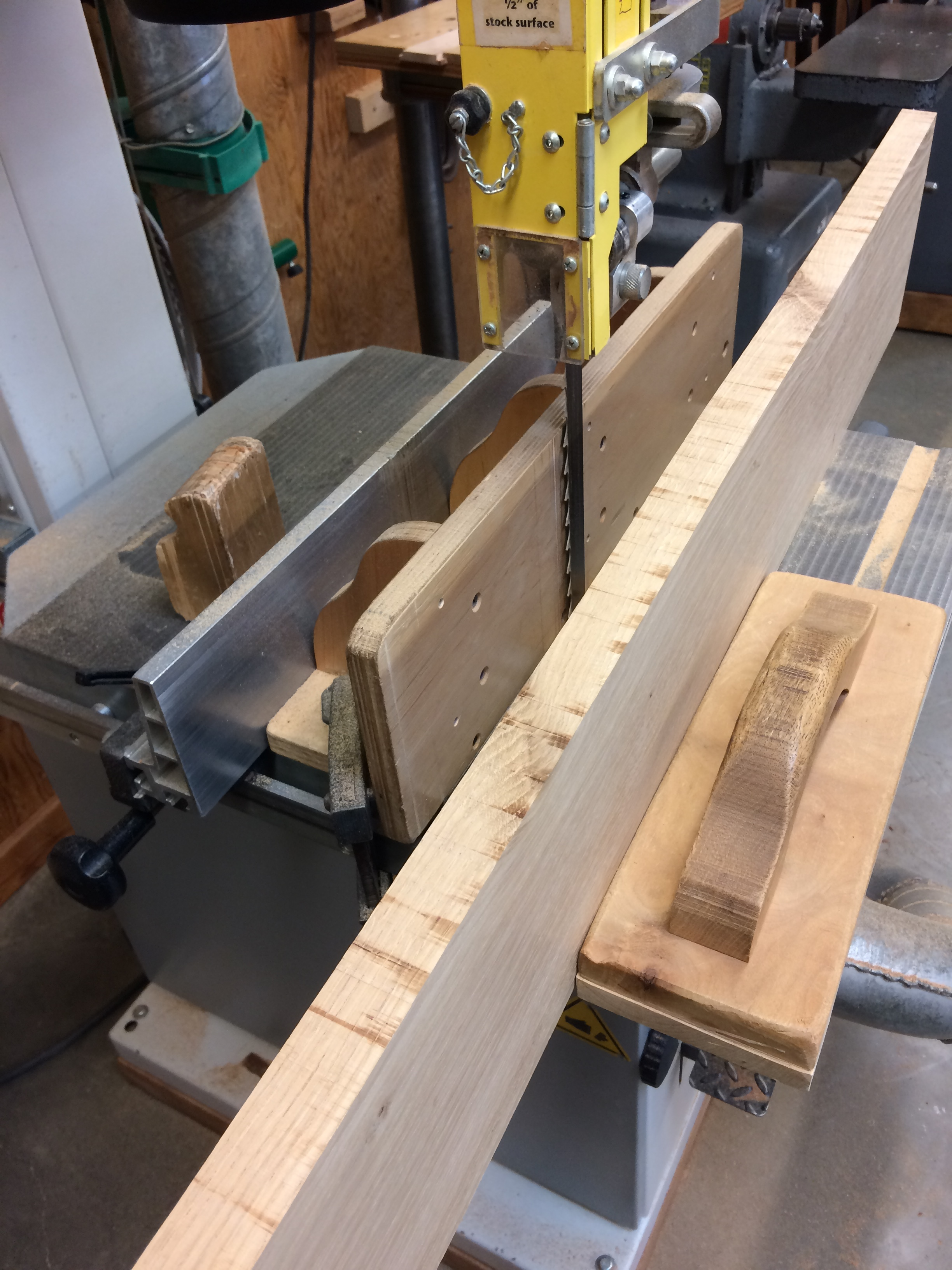 Re-saw the plank to make veneers.