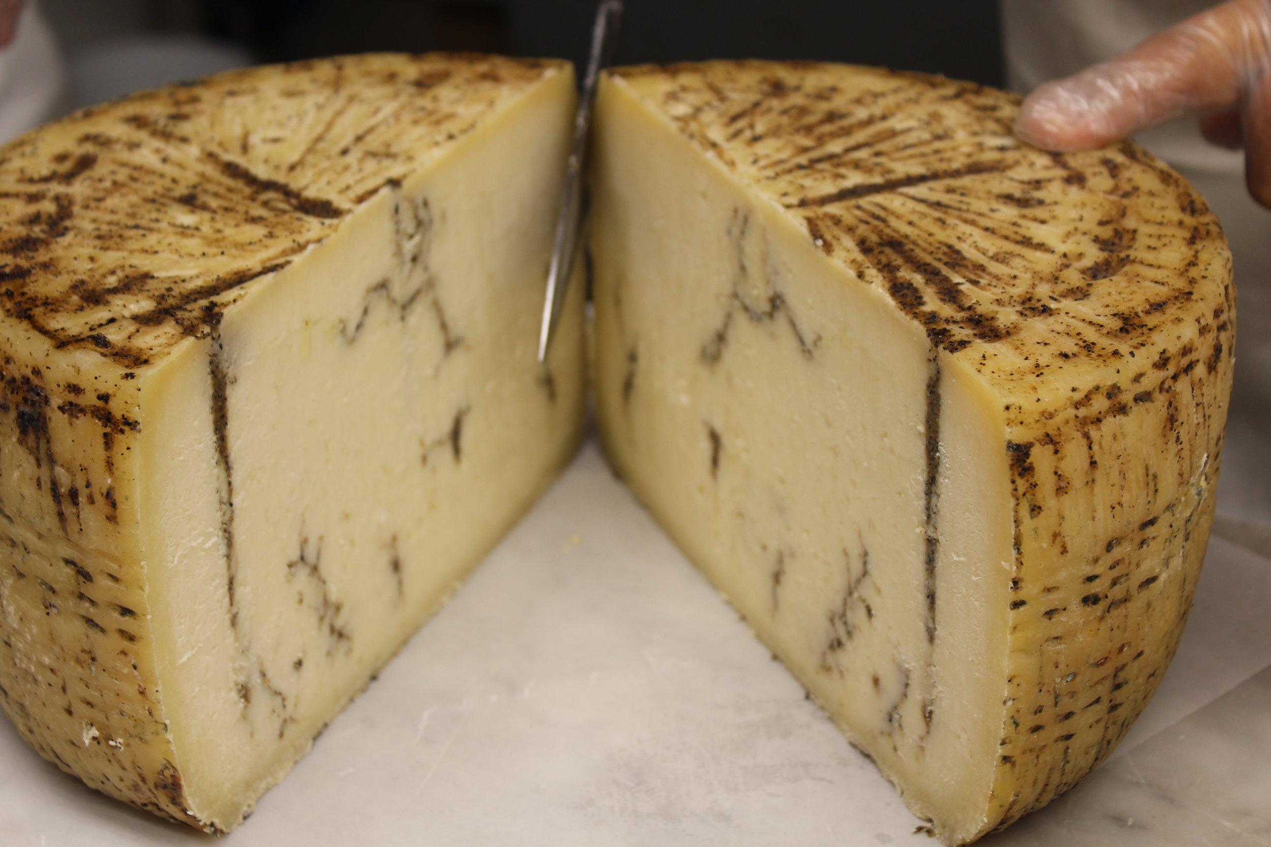 Pecorino cheese from Sardegna infused with ribbons of black truffles at Calandra's Cheese.