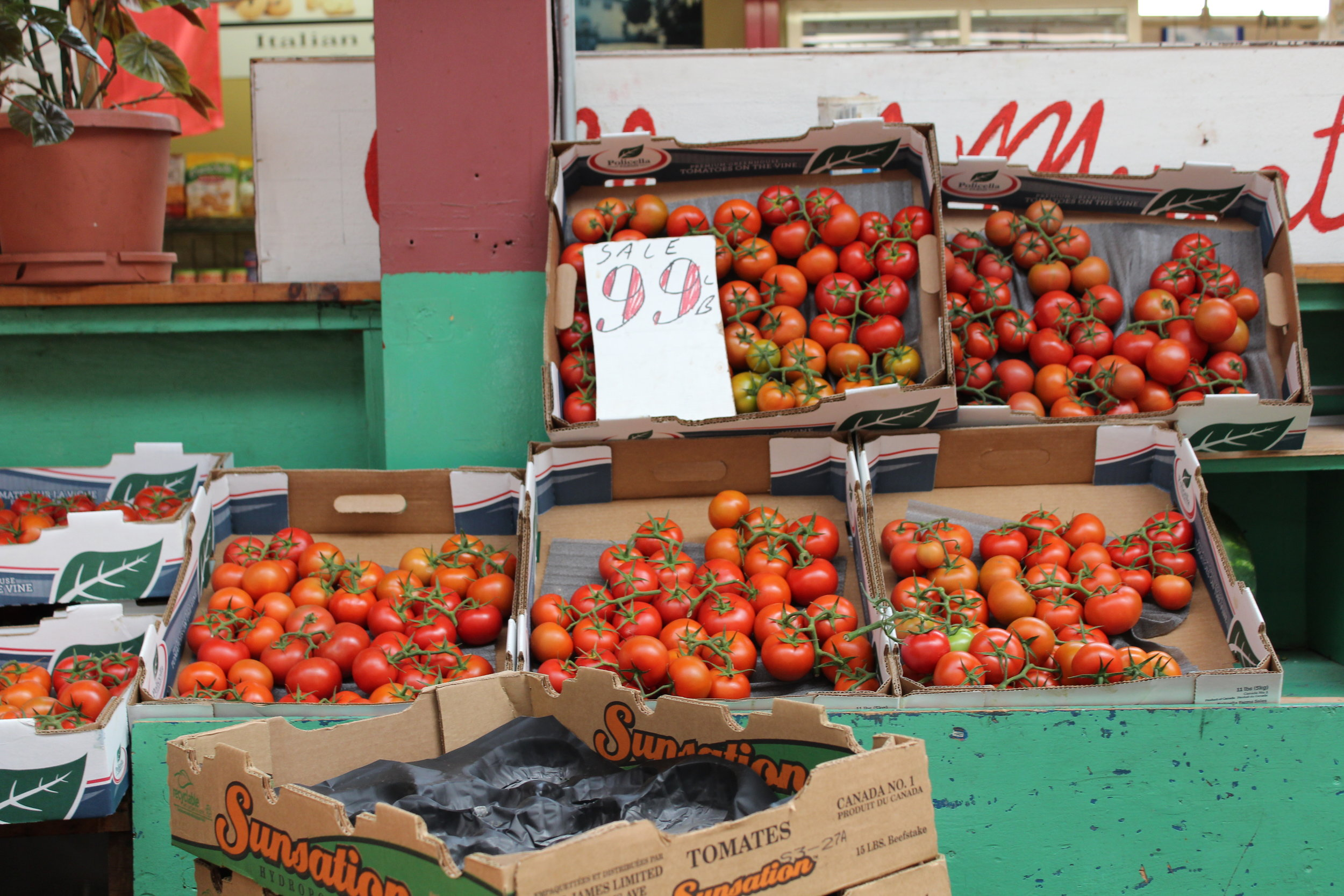 Buy tomatoes at Boiano's, the vegetable stand inside the Arthur Avenue Retail Market.