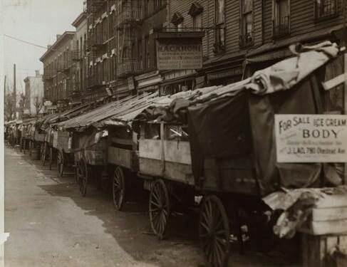 Pushcarts lined up on Arthur Avenue looking toward 187th Street.