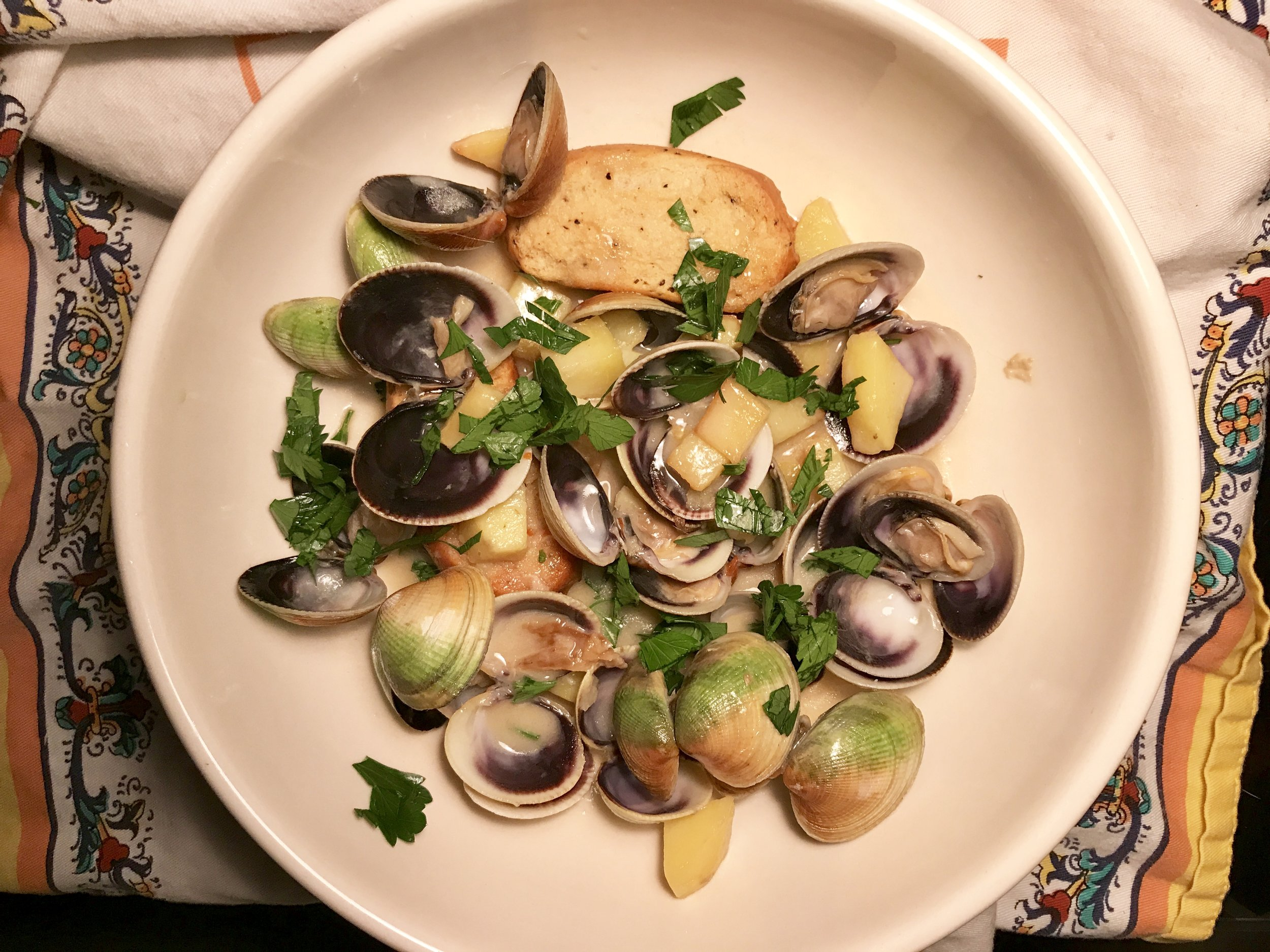 Vongole clams, potatoes and black pepper friselle to soak up the stew's broth.