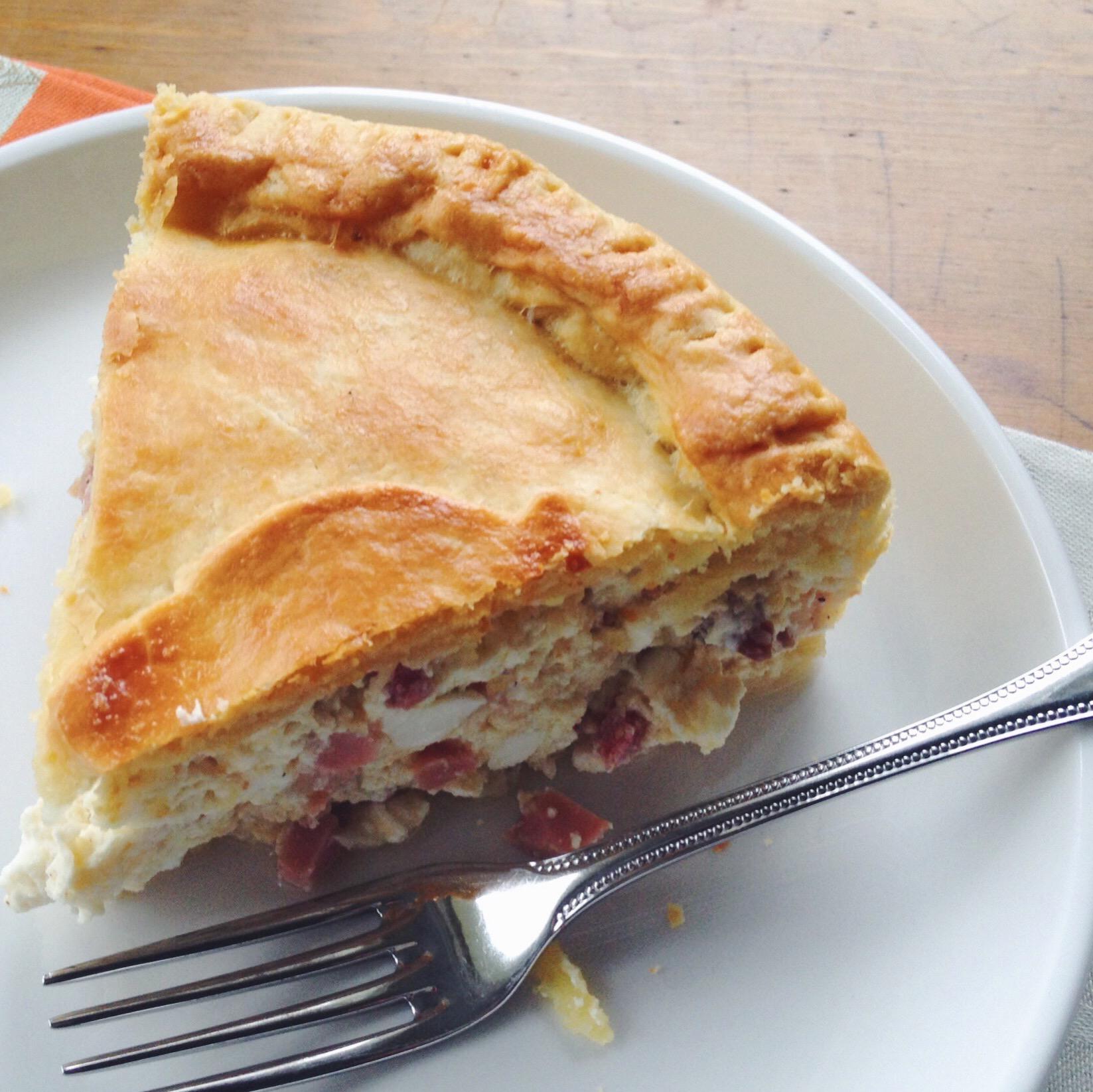 """A slice of pizza rustica or """"a'pizza gain"""" by cookbook author Domenica Marchetti."""