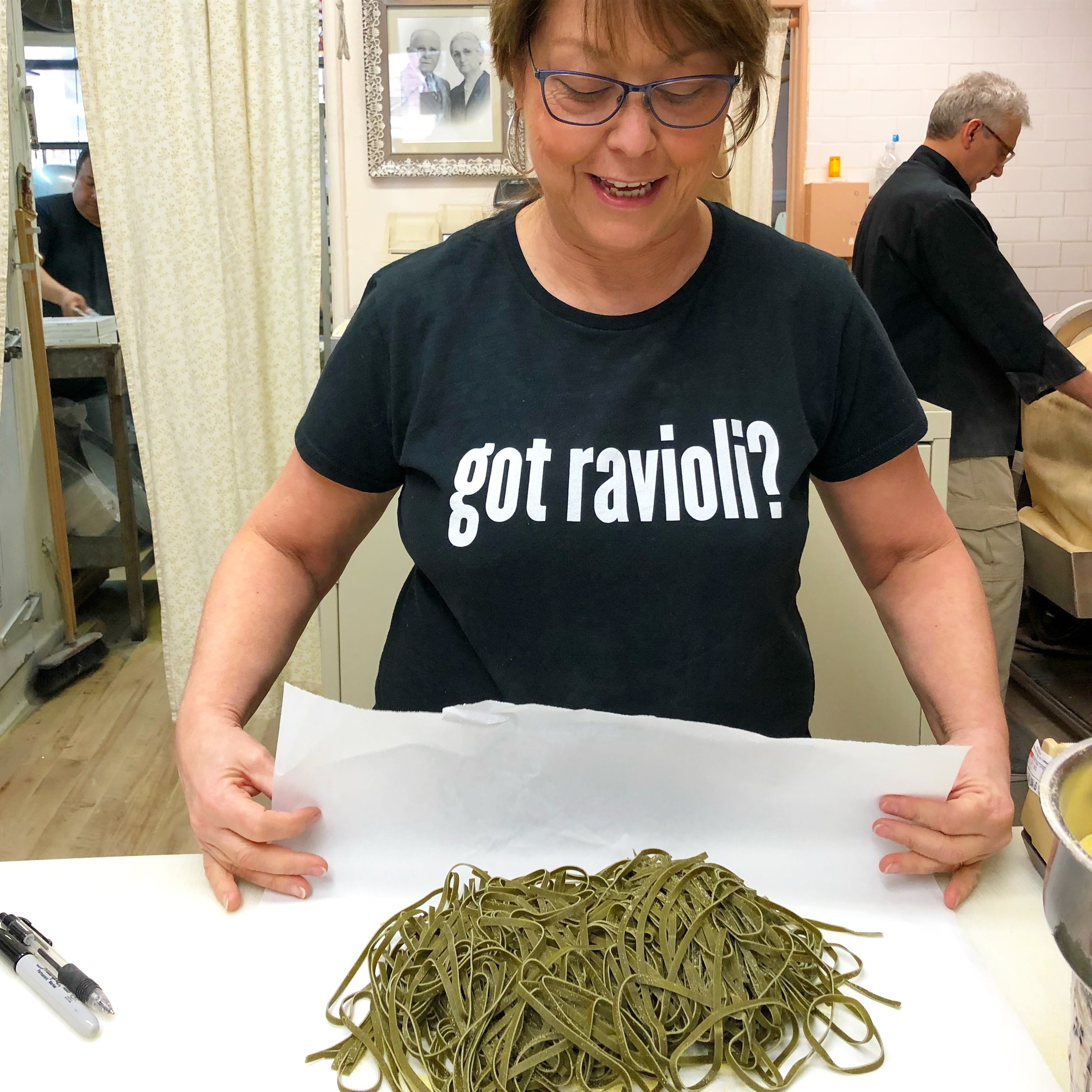 Joan Borgatti showing off freshly cut spinach pasta