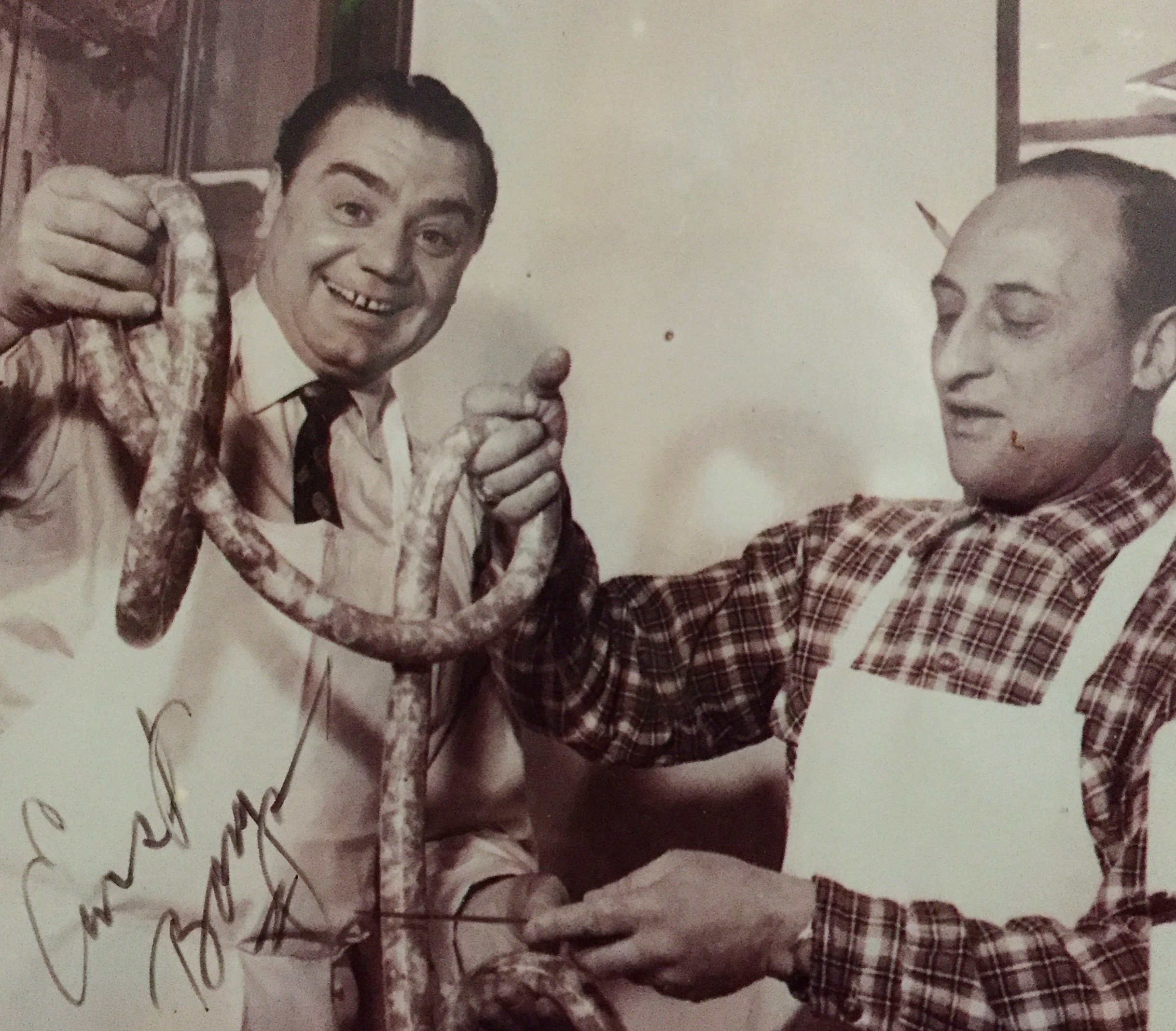 """The Academy Award winning film """"Marty"""" was shot inside Danielle's family butcher shop, now Vincent's Meat Market on Arthur Avenue. This picture shows Ernest Borgnine with her uncle, John Oteri."""
