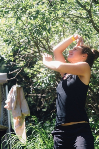 A participant in our workshop held at Frog Fest in 2017 explores movement and connection to self during our session.