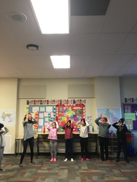"""These students at Dr. Margaret Ann Armour School enjoyed our warm up of """"tapping"""" - an ancient technique used to improve circulation, decrease inflammation, and encourage body awareness through sensory stimulation."""