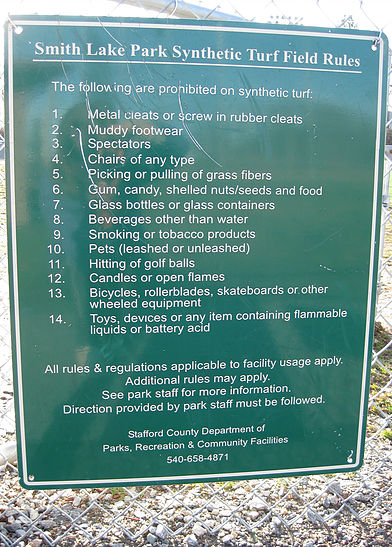 This is where the 'warning signs' get transparent. This sign goes to great lengths to protect the field. (No chairs? No food? No spectators?)