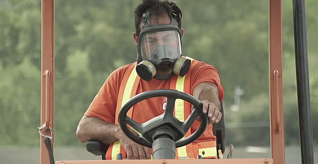FieldTurf workers breathing masks -  Impact inaugurates new synthetic training field next to Stade Saputo 2.jpg