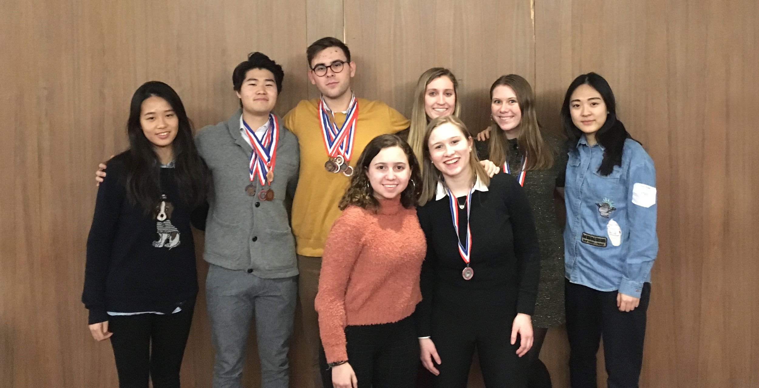 The 2018-2019 Academic Decathlon team pose with their medals following the Indiana state competition at Purdue University, Februrary 9, 2019. Left to right, back row: Winnie Liang, Ben Park, Dylan Palffy, Molly Caplice, Elaine Jensen, Amy Wang. Front row: Judy Ulayyet, Charlotte Visconsi.
