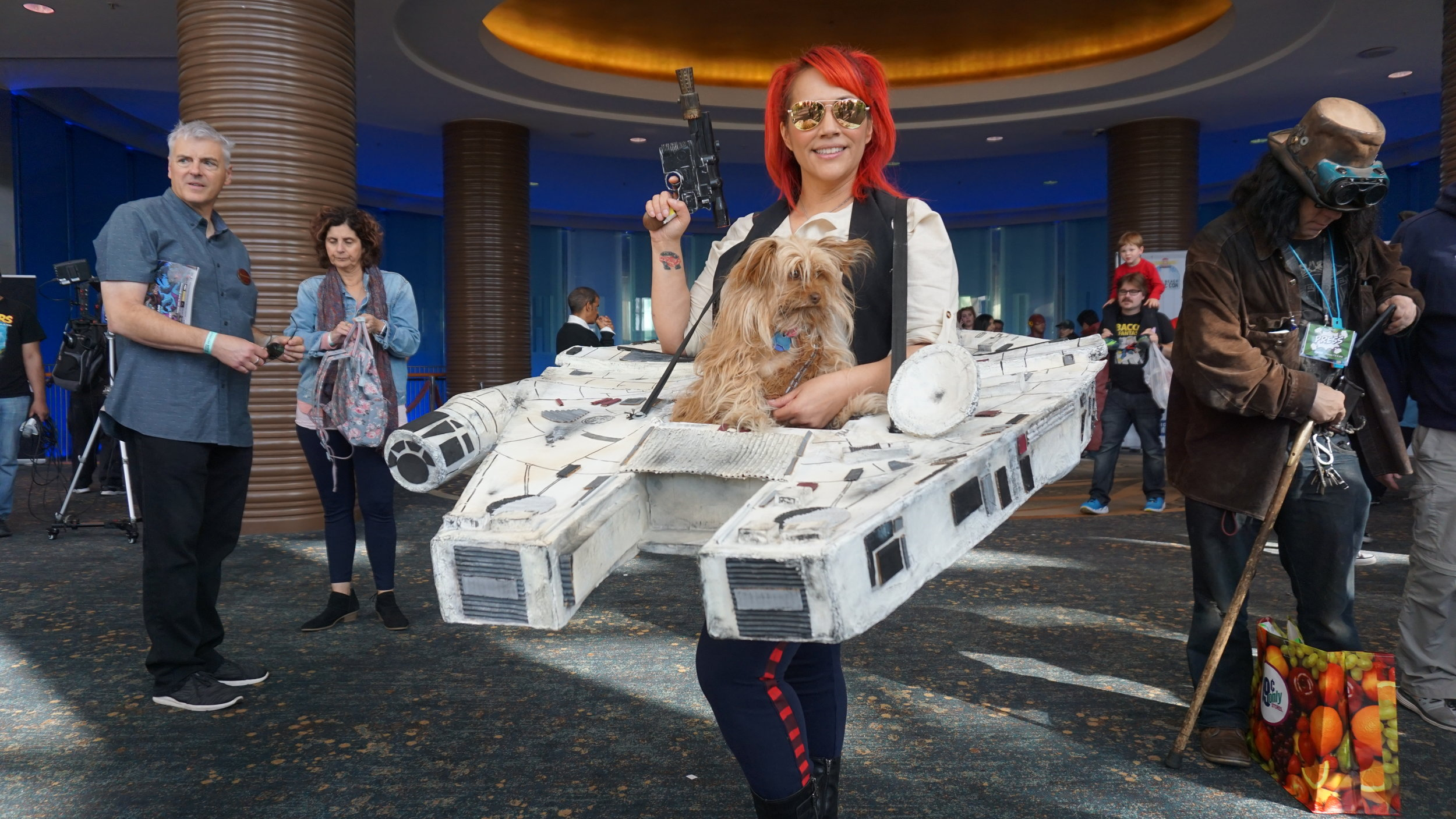 Lady Han Solo with co-pilot Chewbacca and the Millennium Falcon  Instagram: @VicariousVicki_