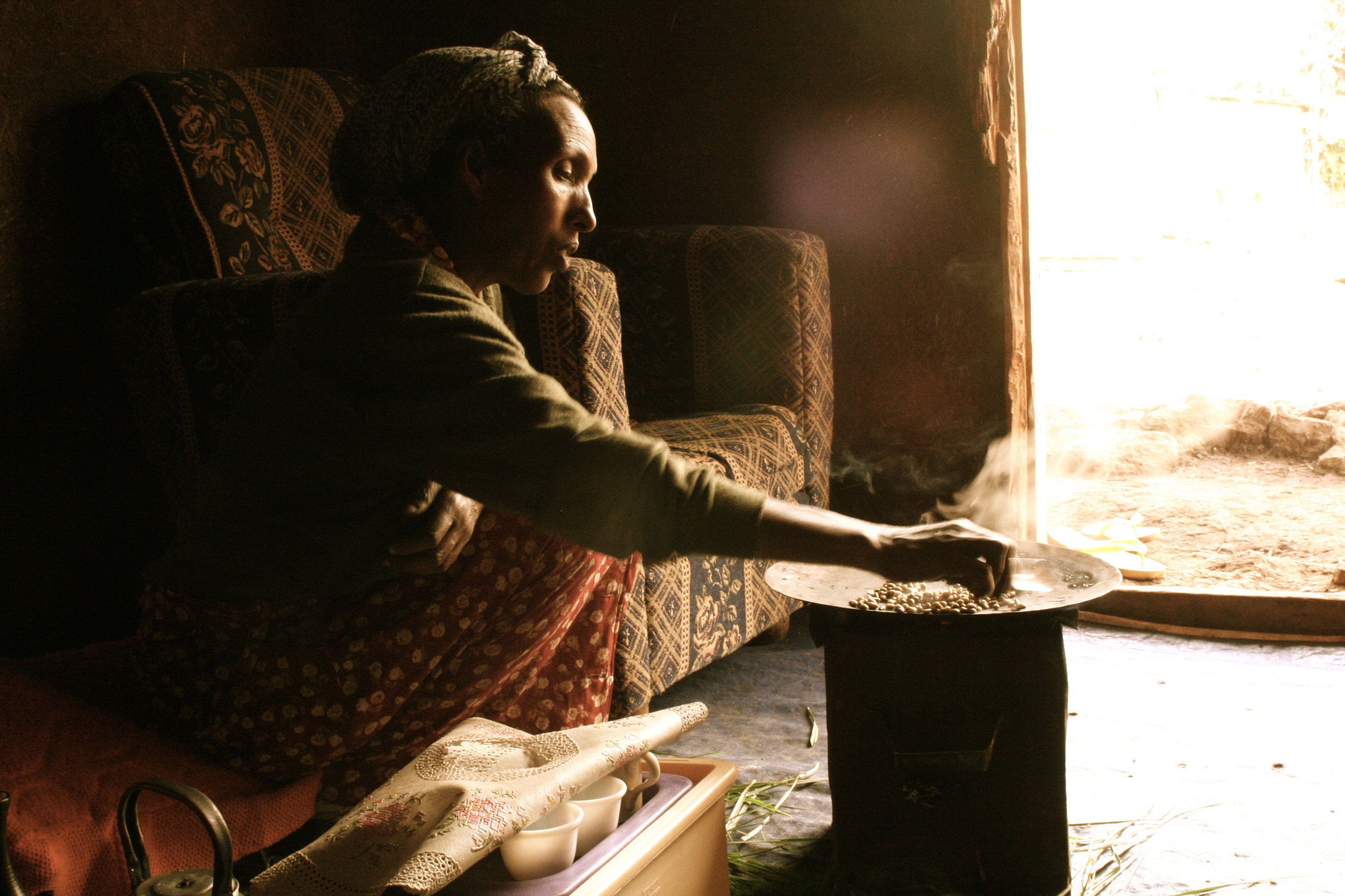 More than just a daily shot of caffeine, coffee in Ethiopia is done slowly.  Meet Etenesh who lives in Addis Ababa, Ethiopia as she roasts her coffee beans over a charcoal stove.