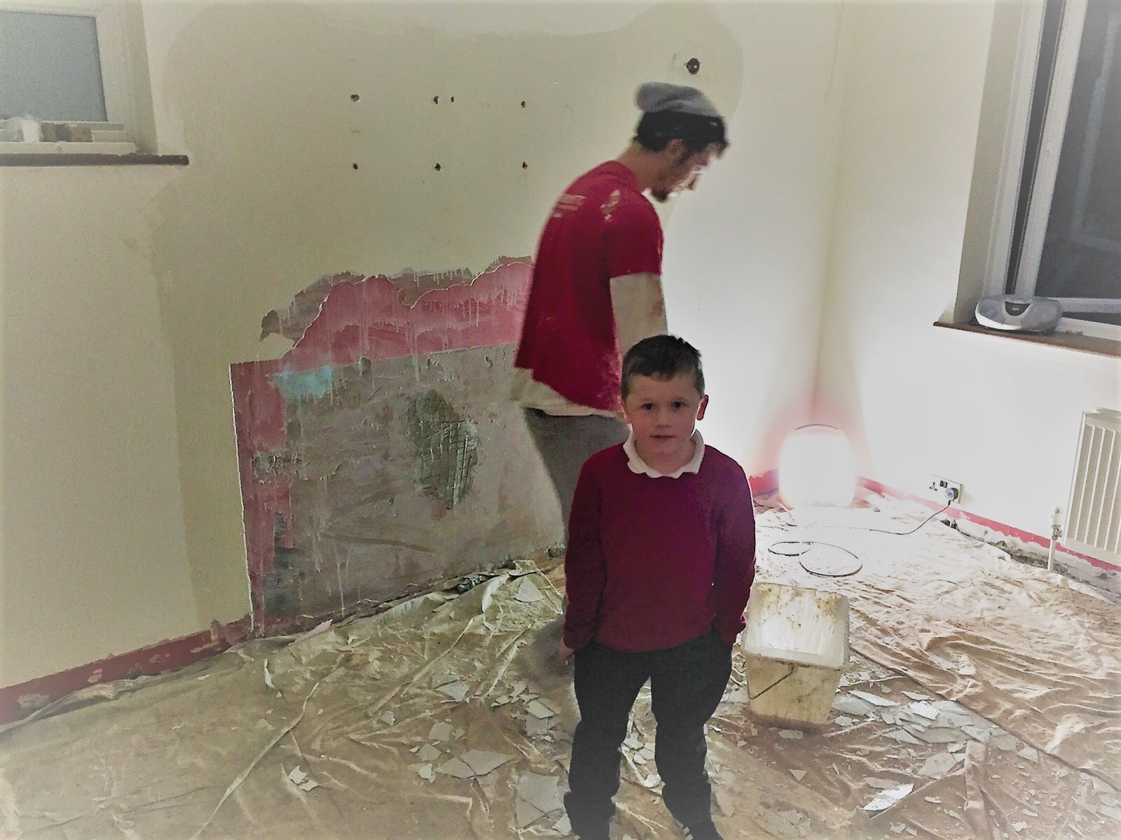 Charlie supervising the plasterers December 2015