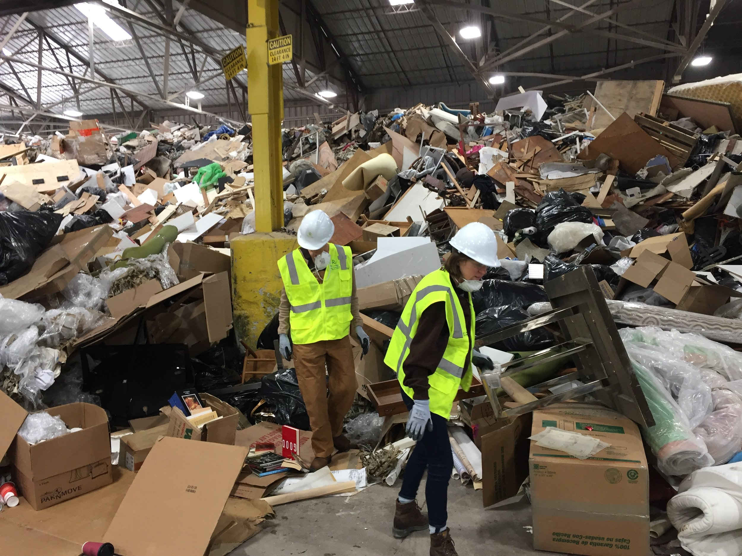 Hughen/Starkweather at Recology San Francisco, searching for discarded, single-use, plastic food packaging for their project about food waste,      Black Gold    .