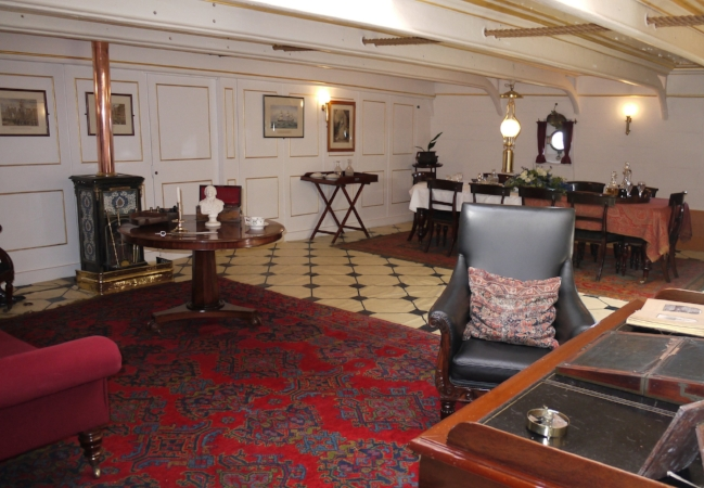 Reproduction of the Captain's day cabin on British steam frigate HMS  Warrior , via    Wikimedia   .