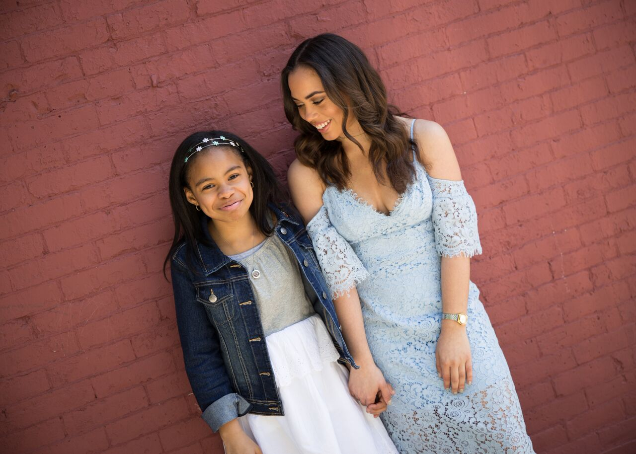 Tiana is wearing a dress by  Gap  with denim jacket and headband by  Children's Place . This beautiful light blue lace dress is by Bardot and available at  Revolve .