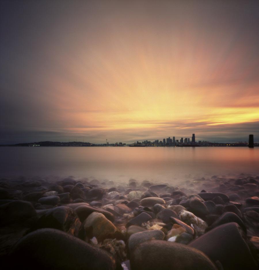 Seattle sunrise, camera nestled among the beach rocks. Zero Image 2000, Kodak Ektar 100.