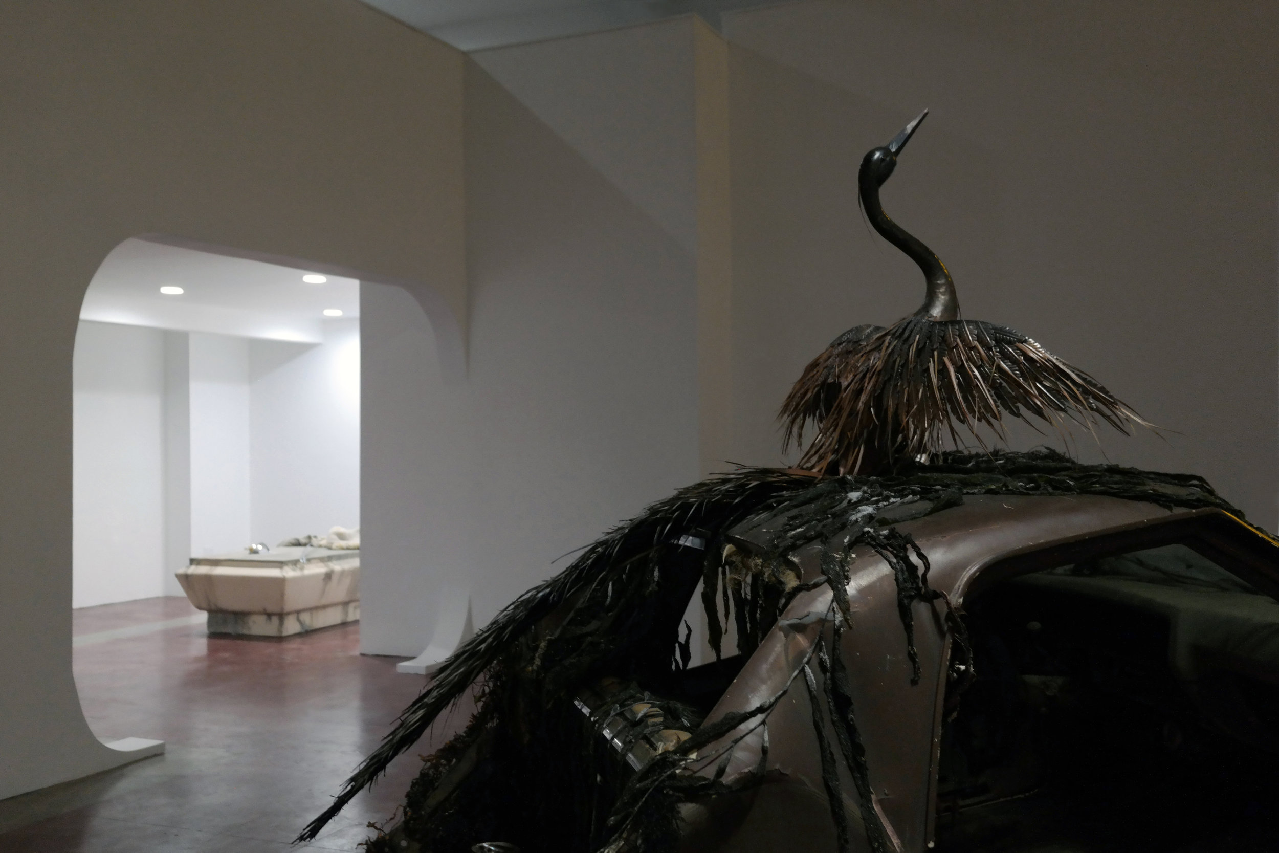 (installation view) Hydrogenesis 1970 El Camino, sand, bronze heron, palm leaf, seaweed, cement, wood, candle, sea urgent, salt 2017