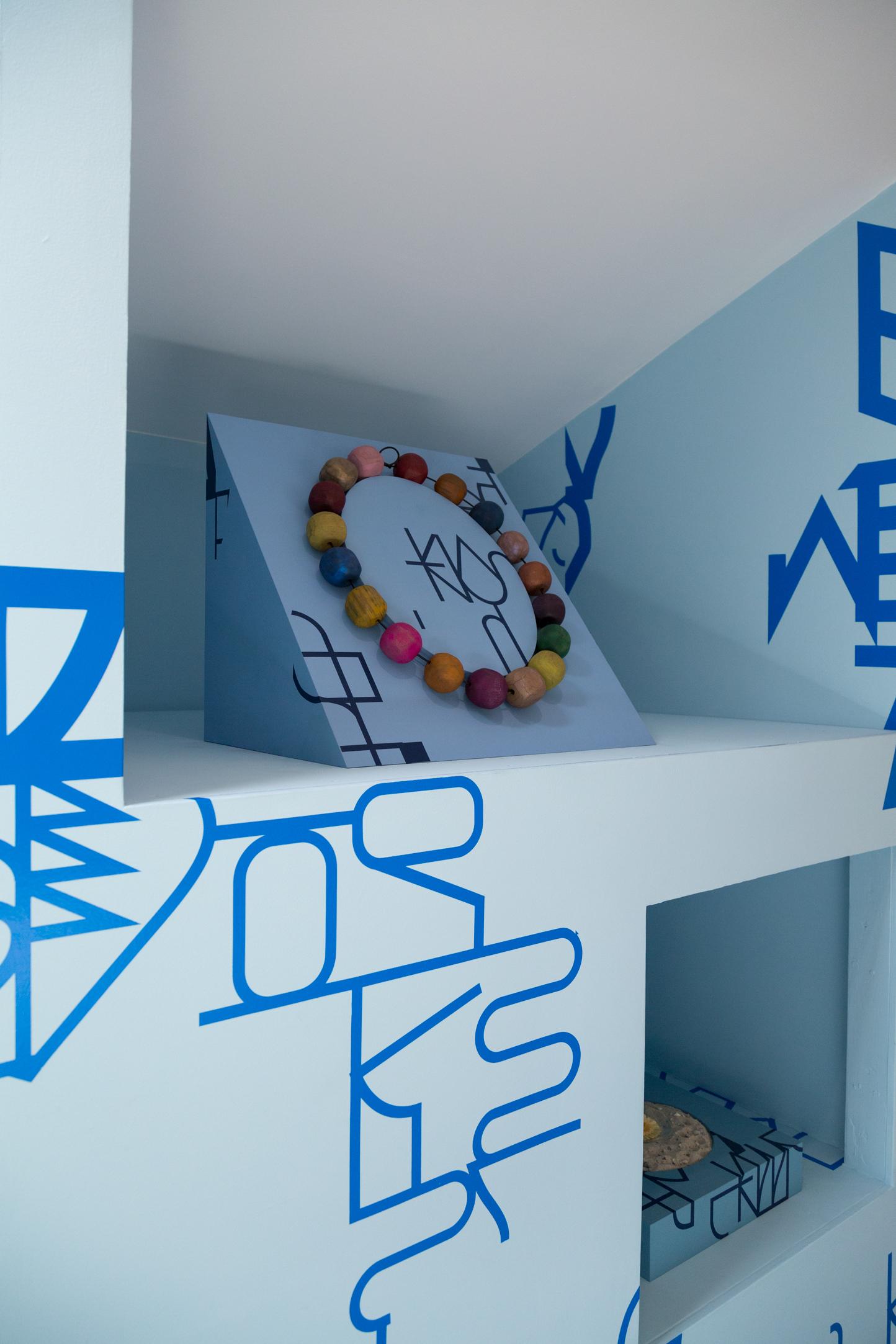 Big Blue Bees  vinyl wall installation, custom shelves, Necklace, Books, Sand, Flower, Edition of 10, 2017