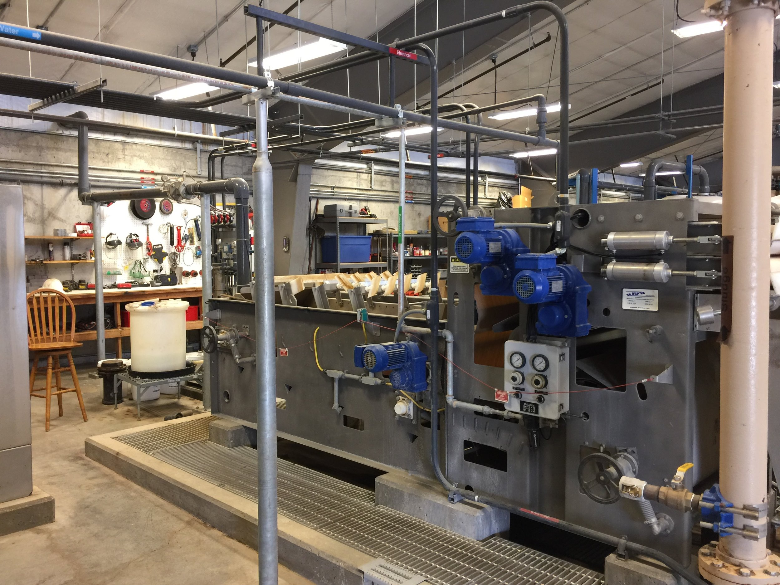 13. Belt filter press - Used to remove the most of the water from the sludge in the backwash tank prior to disposing.
