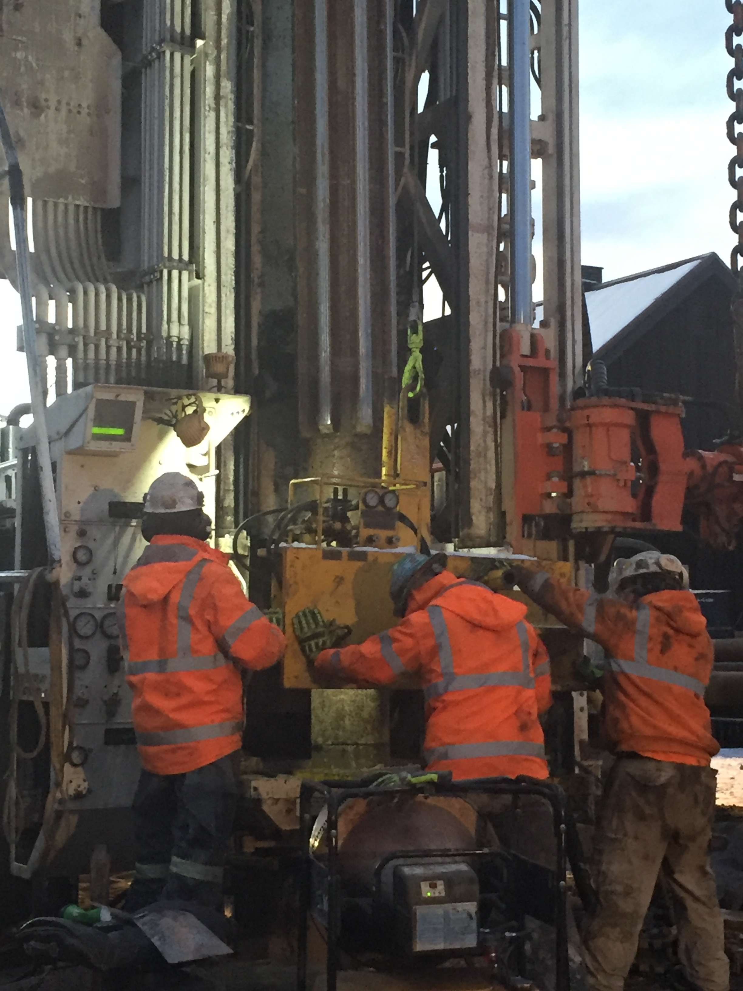Drill rods and reamer entering the borehole.