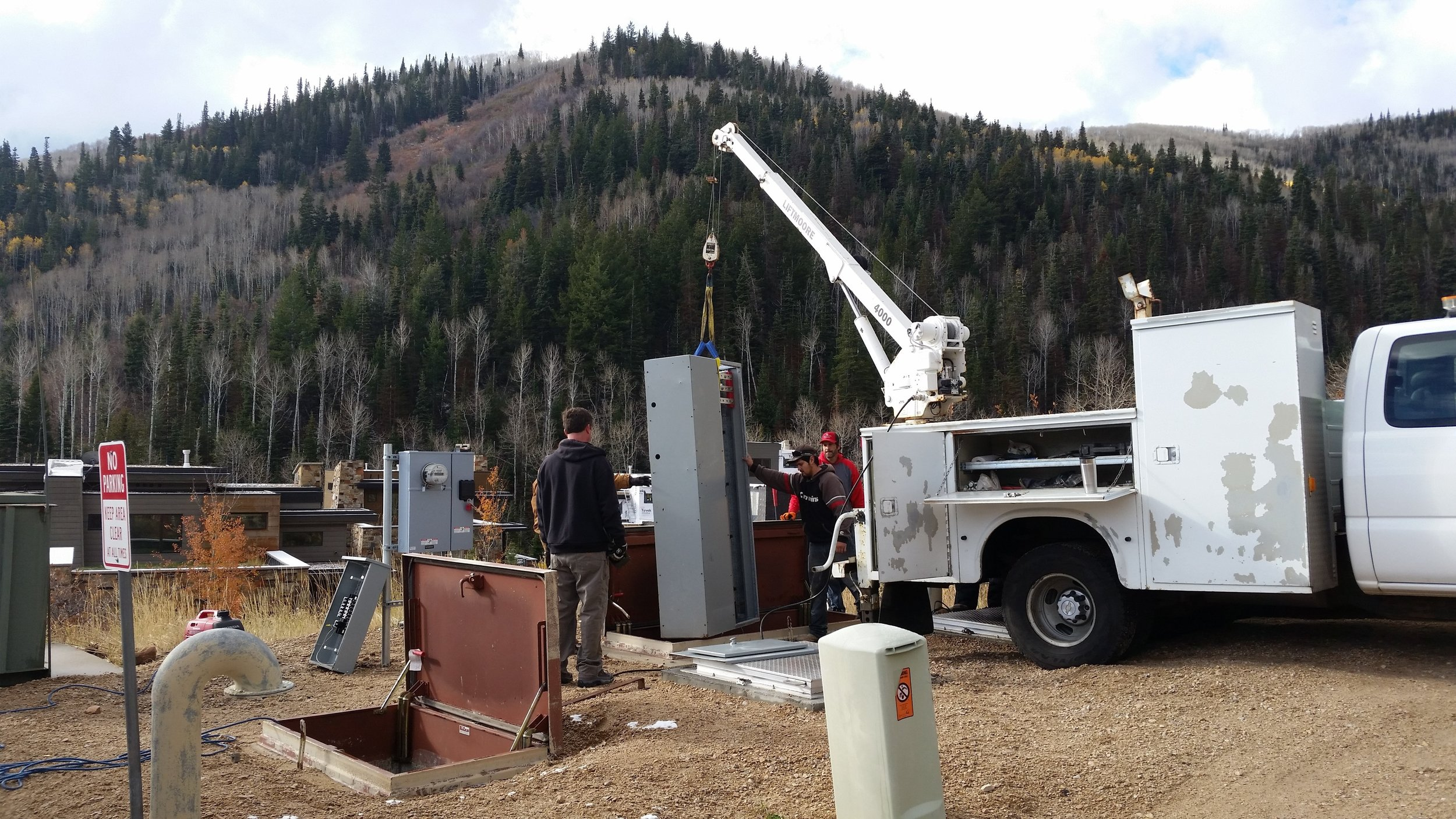 Installation of new energy efficient motor control center into underground pump station in Bear Hollow.