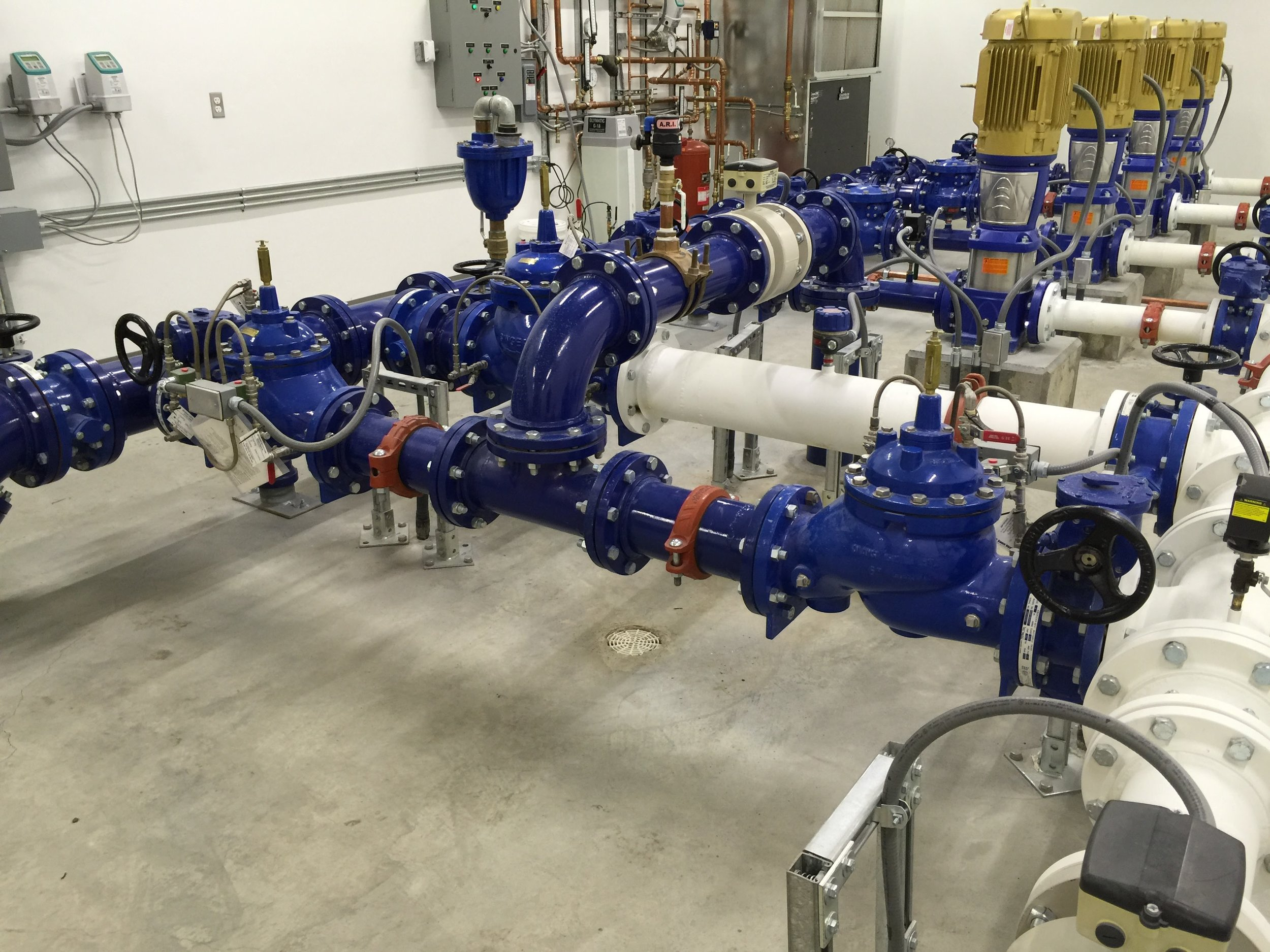 One of our new high efficiency pump stations serving middle valley of promontory. This design uses only about half of the power demand of a conventional pumping facility.