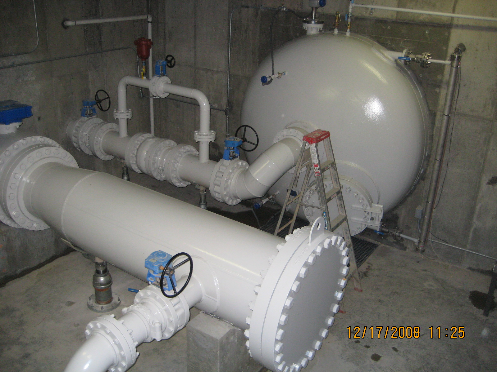 Large water surge tank below pump station to handle water hammer in the event of a power failure. Pipeline PIG launching facility is also shown.