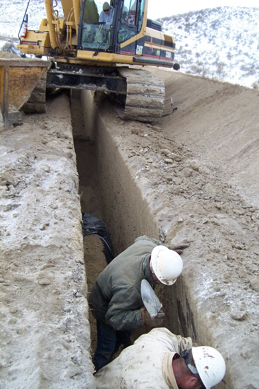 View of pipeline trench in rock after cut.