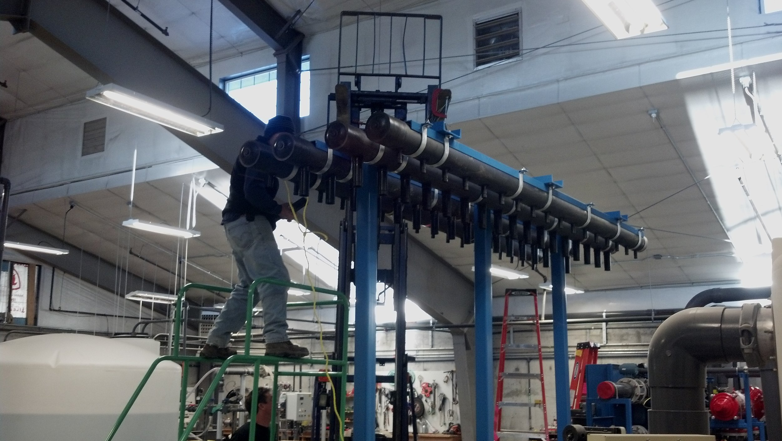 Assembling the header of the new 1 MGD plant expansion skid.