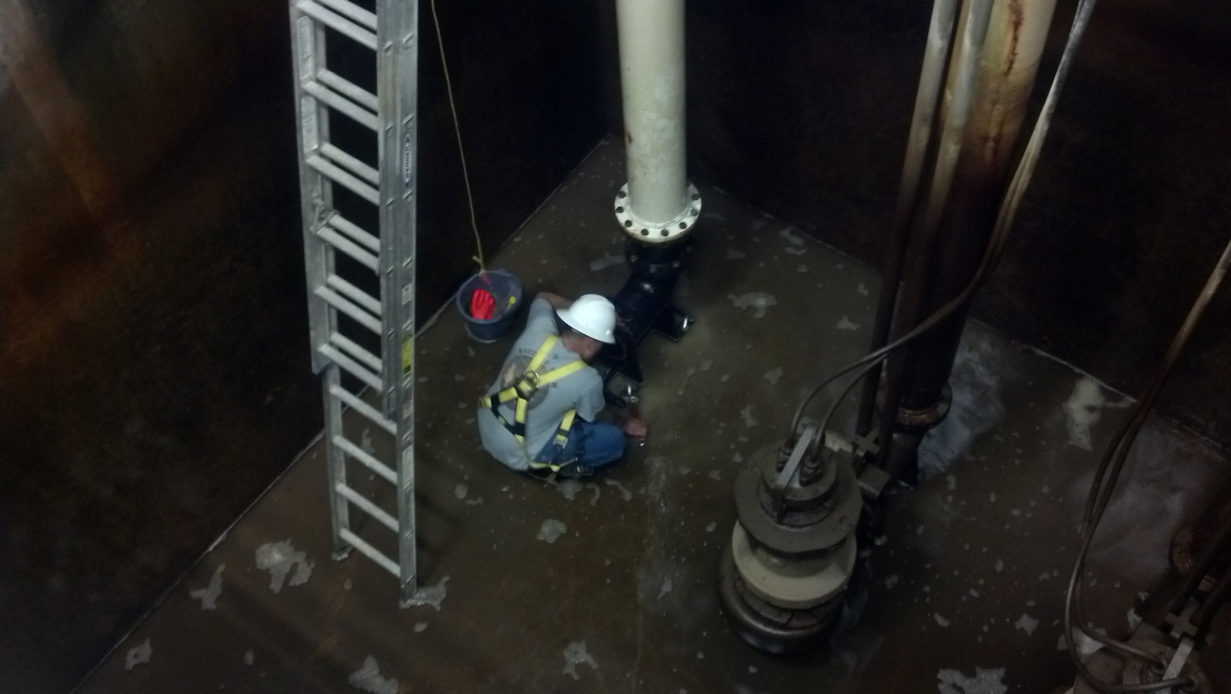 Installing a new feed pump in the plant intake wet-well, used to feed the new 1 MGD treatment skid expansion.