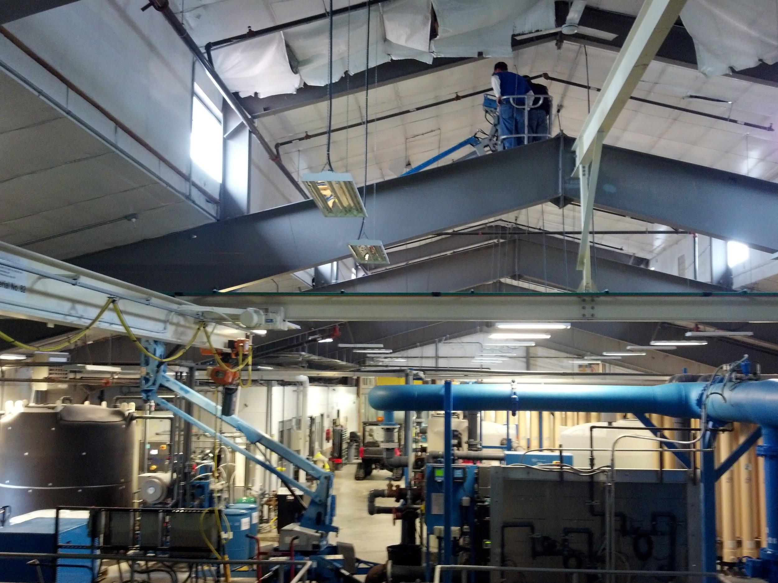 Operators repair a roof problem at the plant.