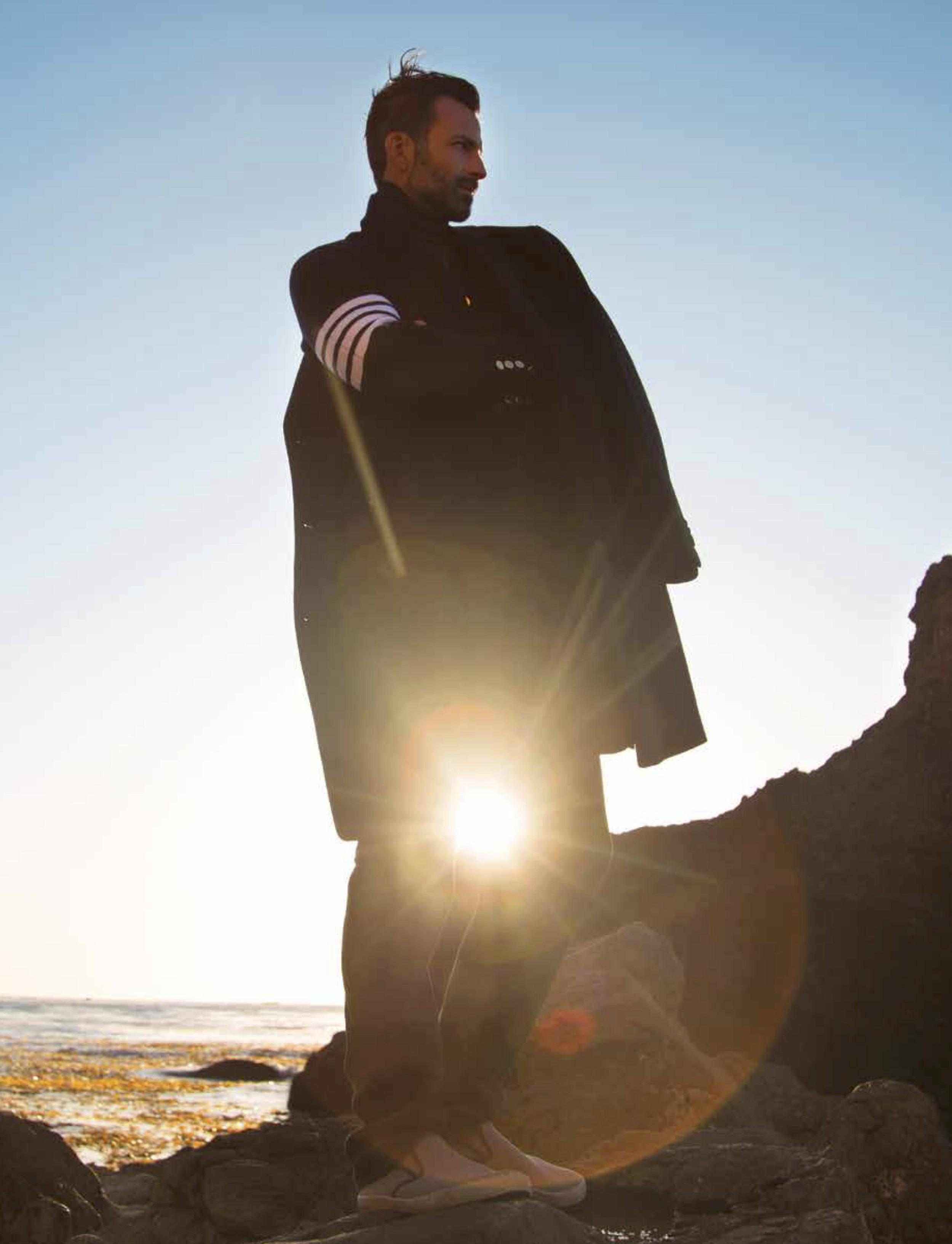 Coat: Hugo Boss Knit Sport Jacket: Thom Browne Ribbed Turtleneck: Tom Ford Corduroy Pant: AG Shoes: Sea Vees