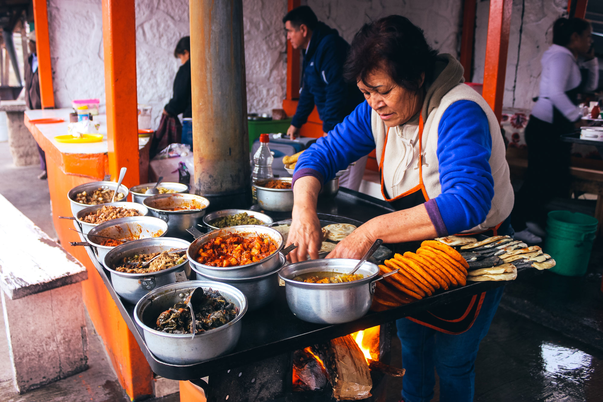 A woman makes gorditas at Divisadero Station, a stop on the way to Urique laying at the base of the Copper Canyons.