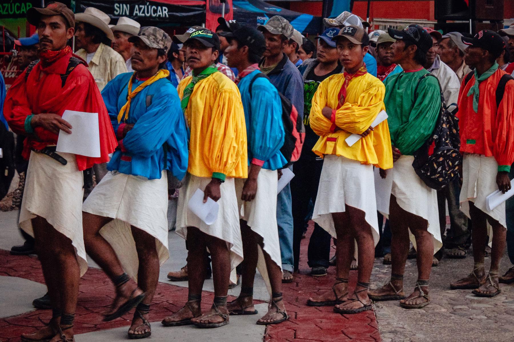 Raramuri men wait to pick up their bib numbers for the Caballo Blanco Ultramarathon.
