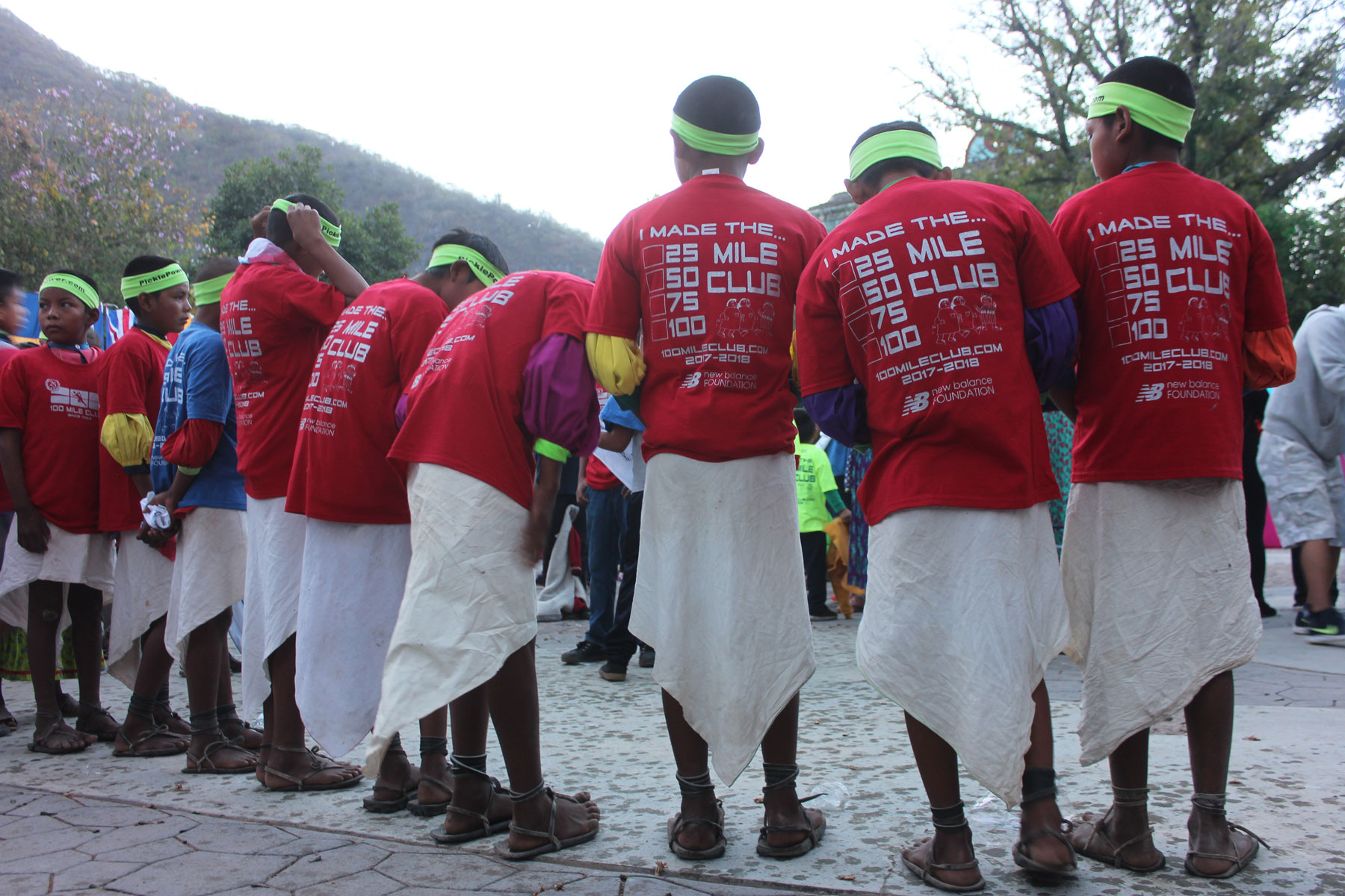 Rarmuri boys in 100 Mile Club t-shirts and traditional clothing.