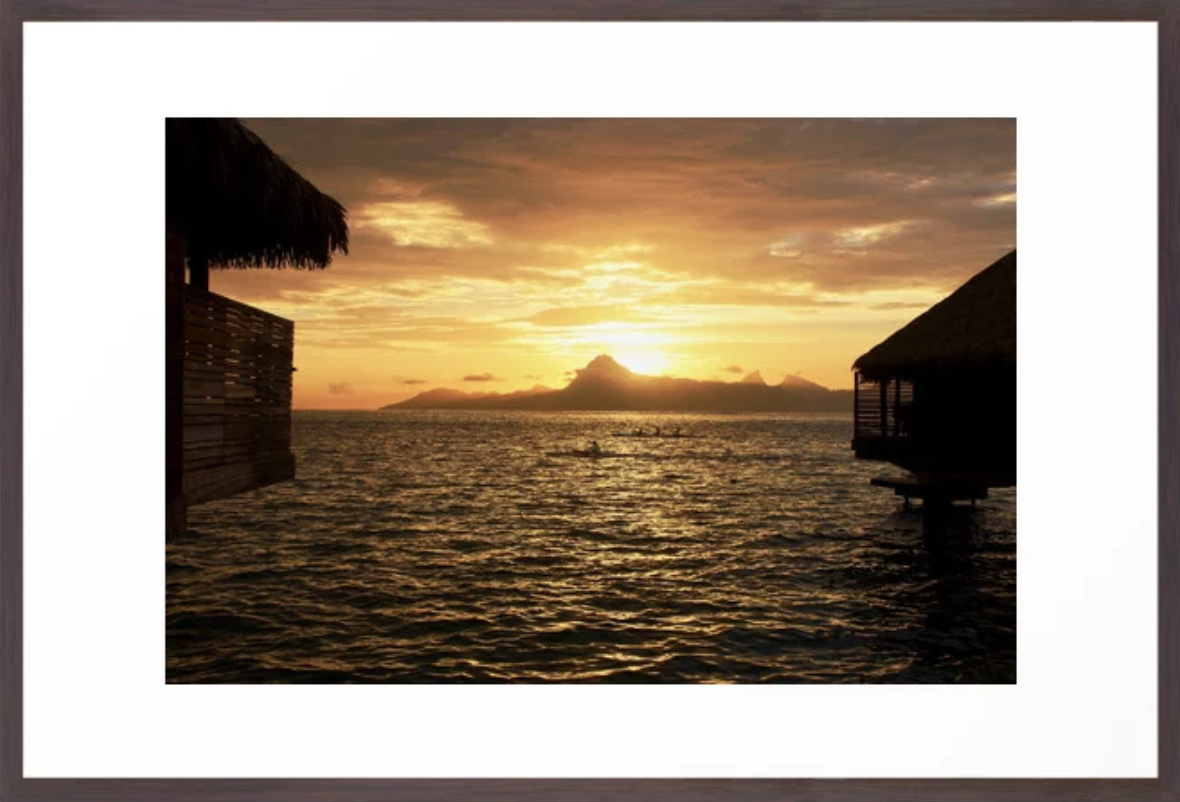 Golden Sunset behind Moorea with Kayakers. Prints and more with click at Society6.