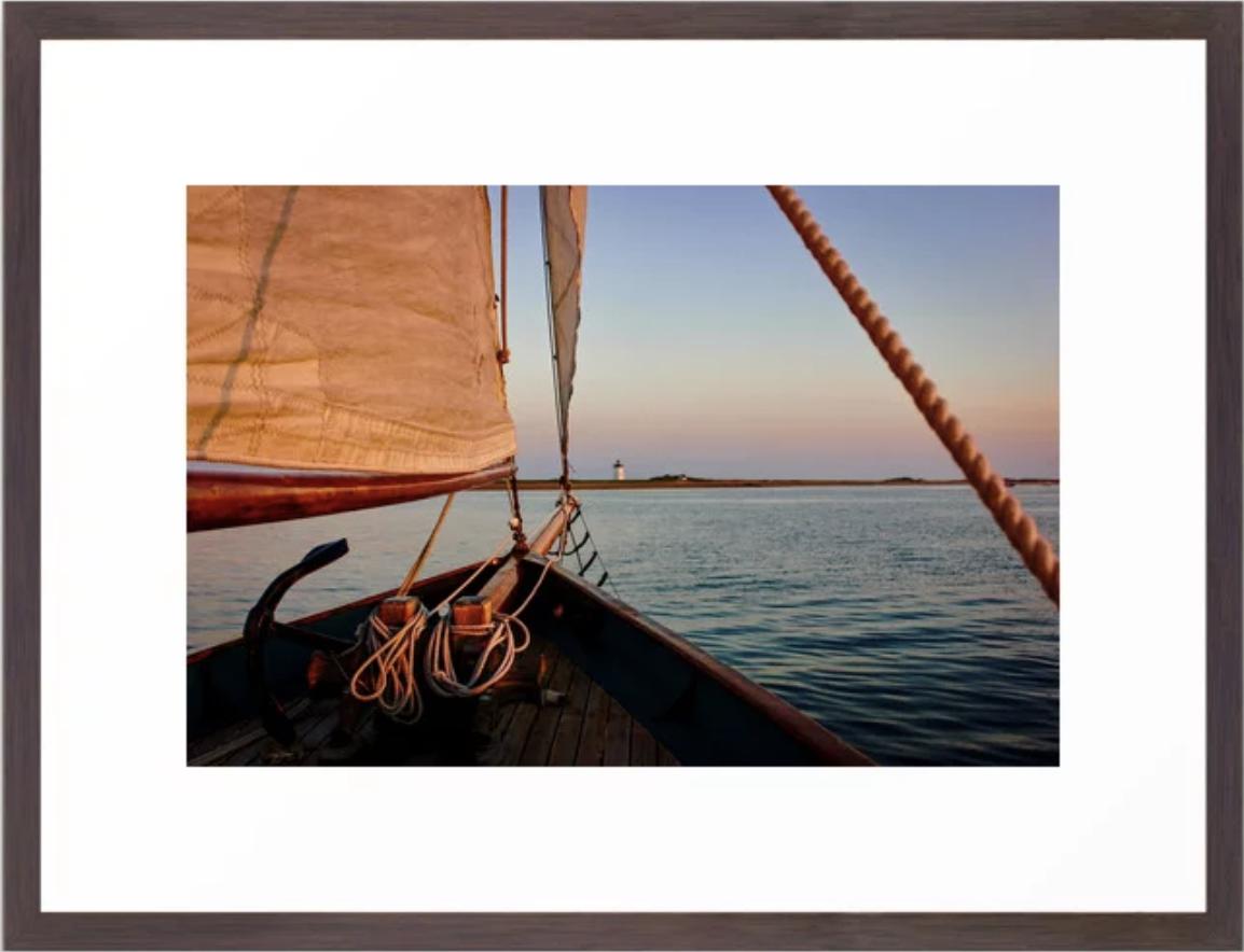 Sailing Towards Lighthouse at Sunset Framed Art Print. More items at:  Ryyoung