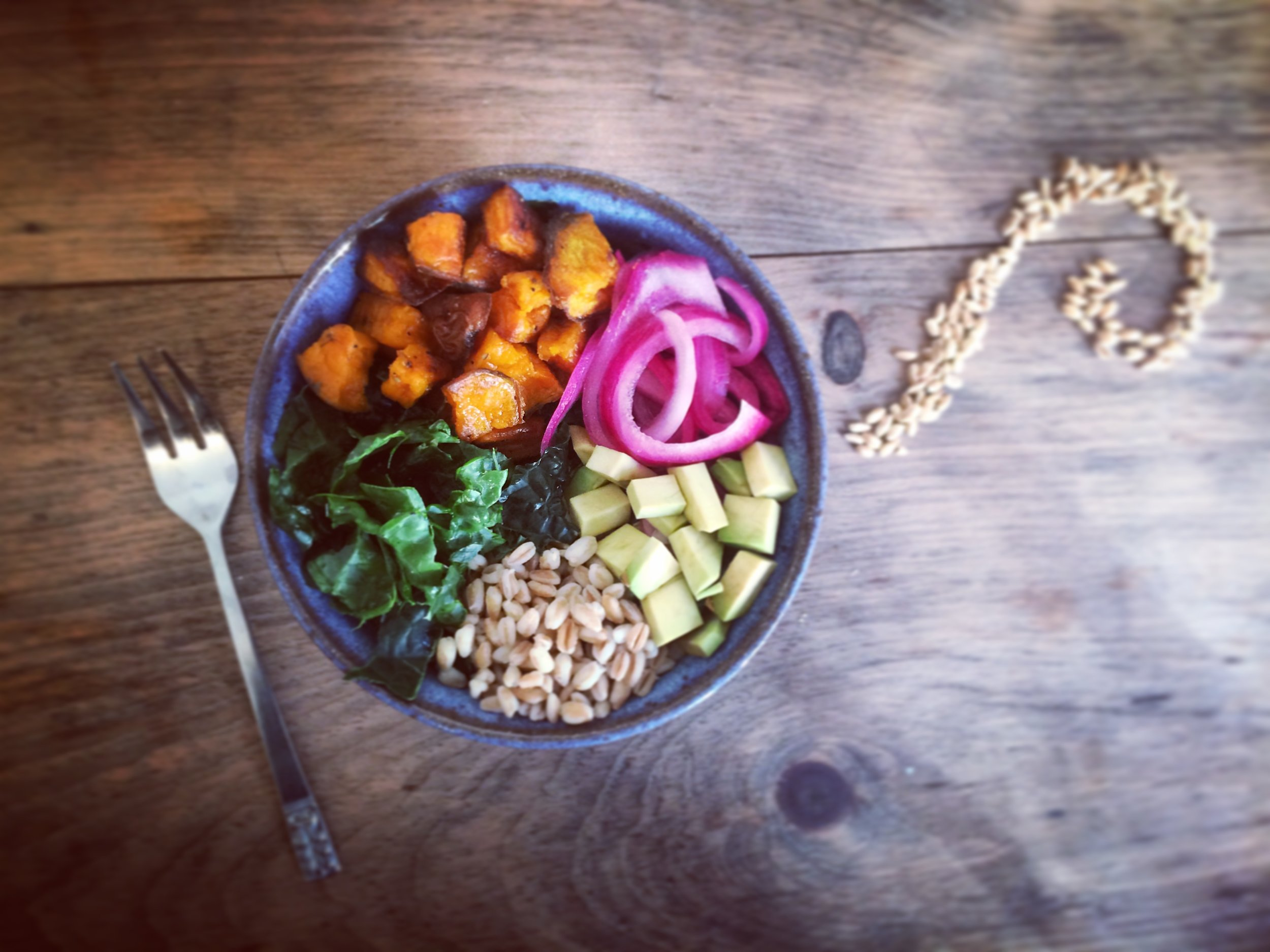 sweet potato farro bowl with pickled red onion and nutty tahini dressing